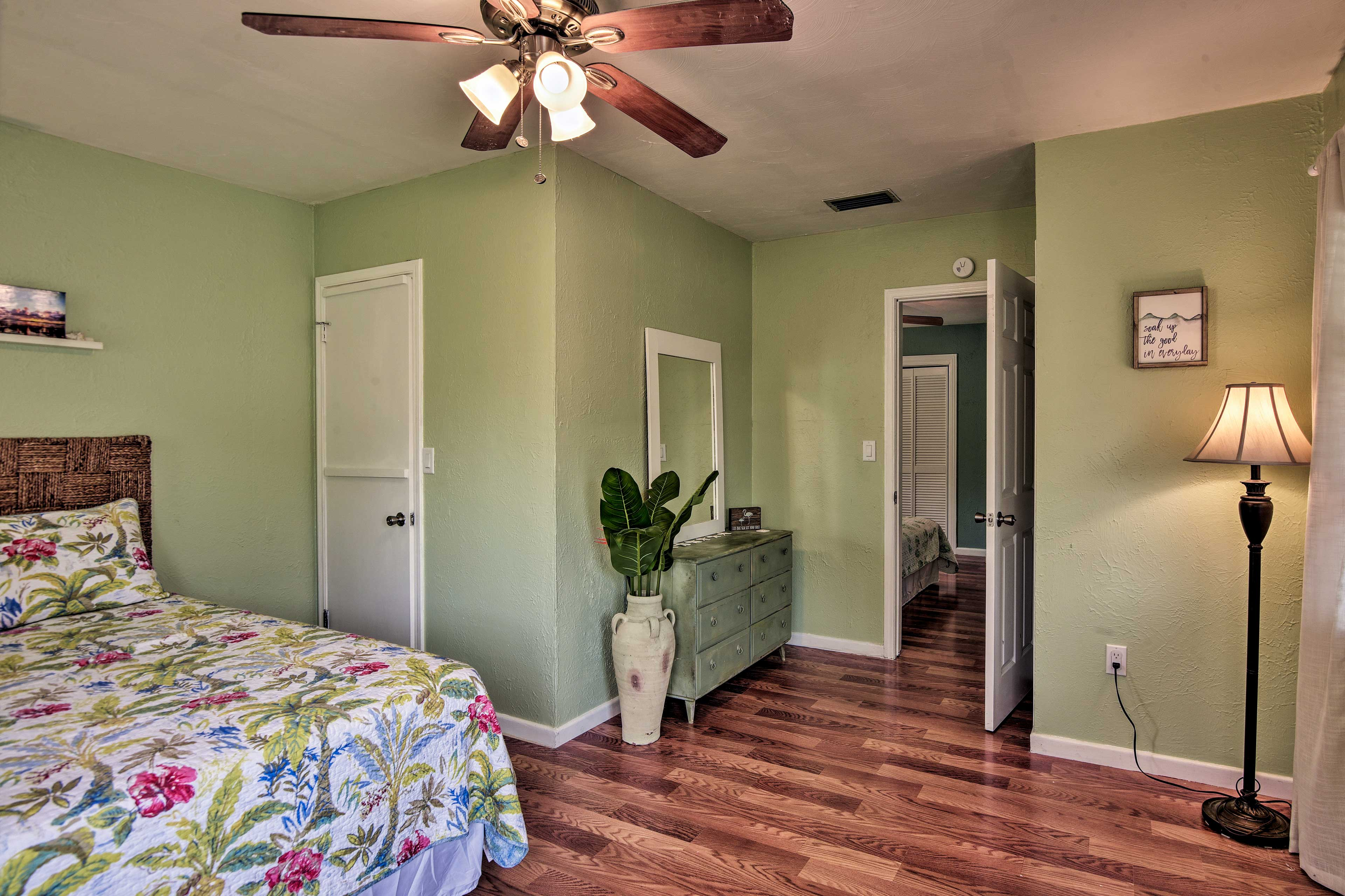 Spacious and cozy, this bedroom features a queen bed.