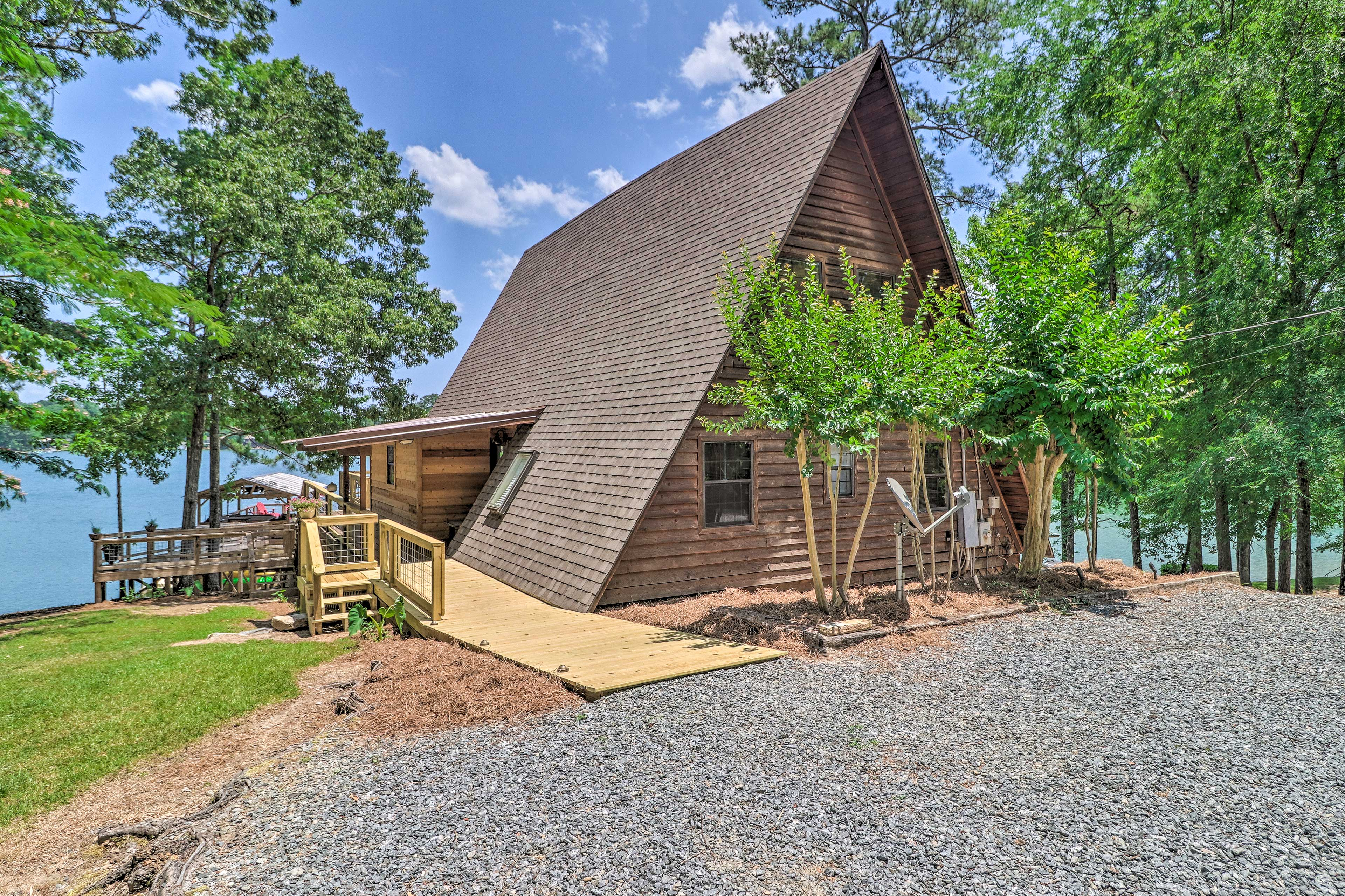 The A-frame cabin boasts stunning waterfront views!
