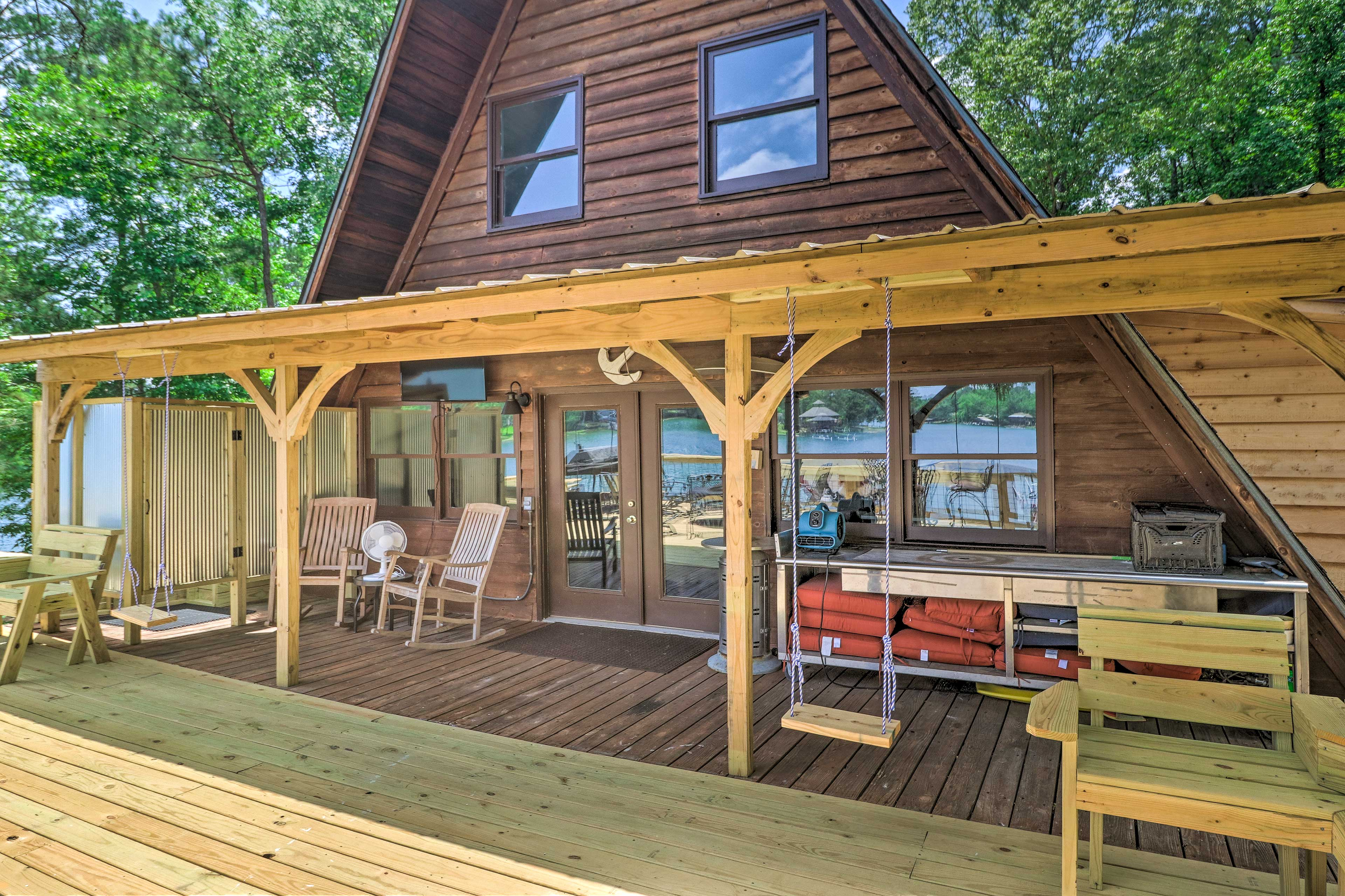 The spacious deck includes porch swings and rocking chairs.