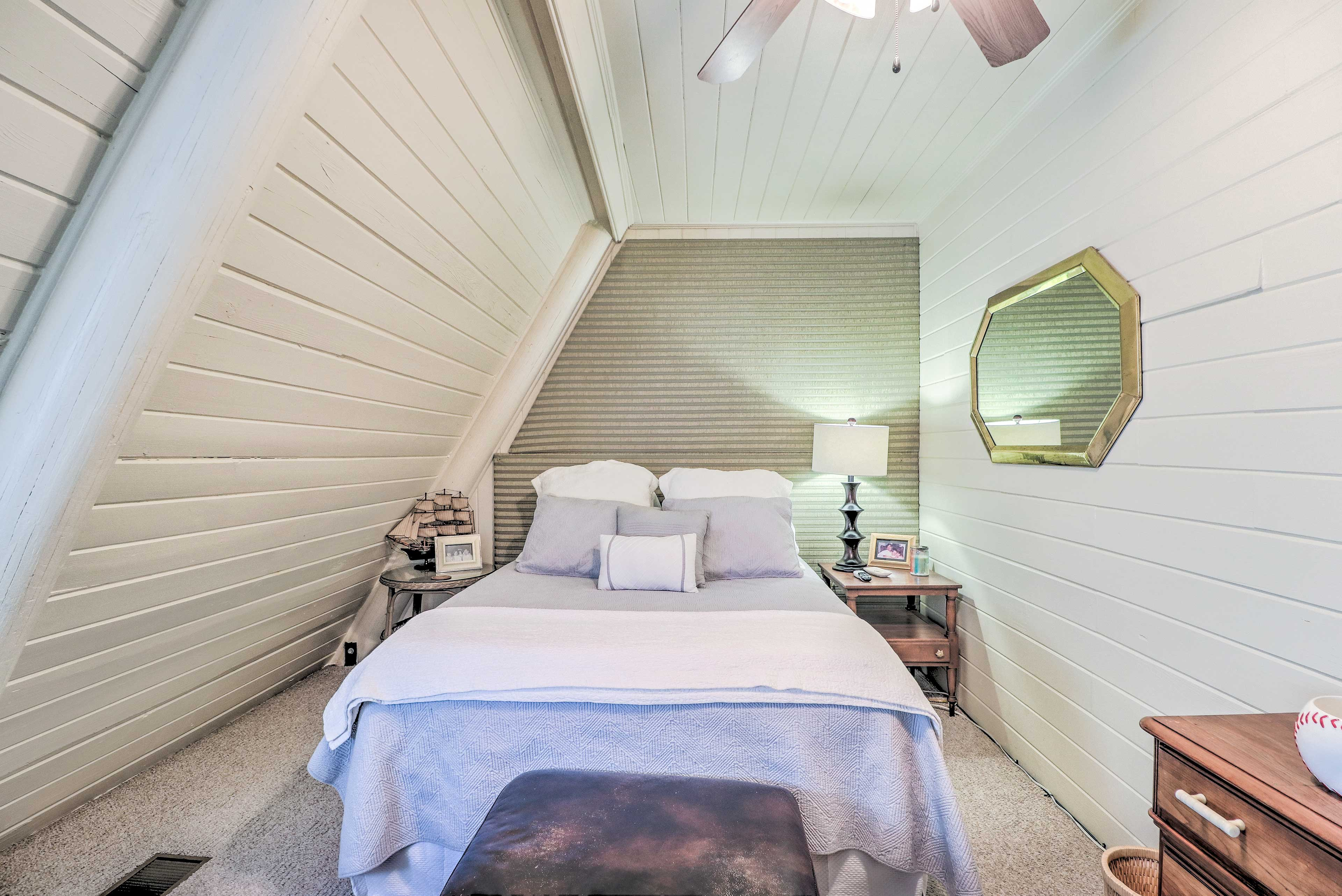 The 3rd bedroom features a queen-sized bed.