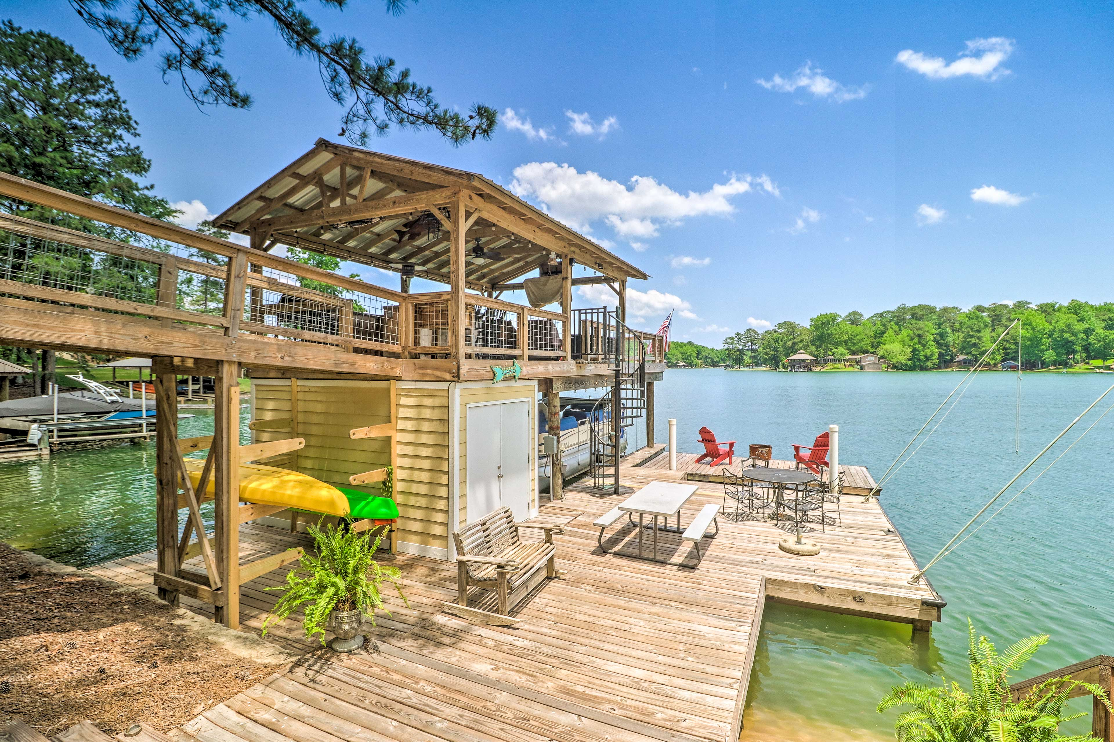 Lakefront paradise awaits at this 3-bedroom, 2-bath Eclectic vacation rental!