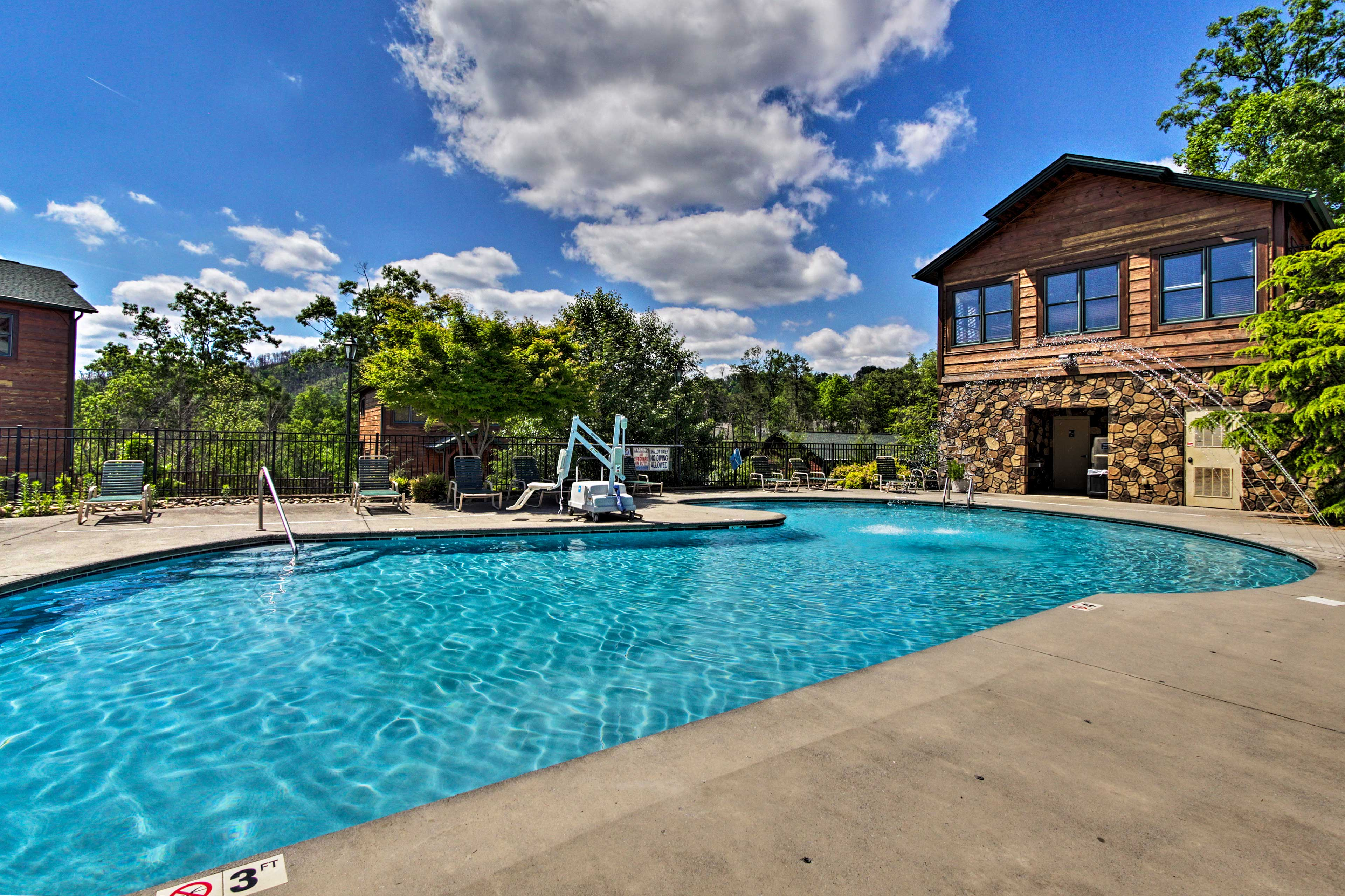 The community pool boasts ample seating in the lounge chairs.