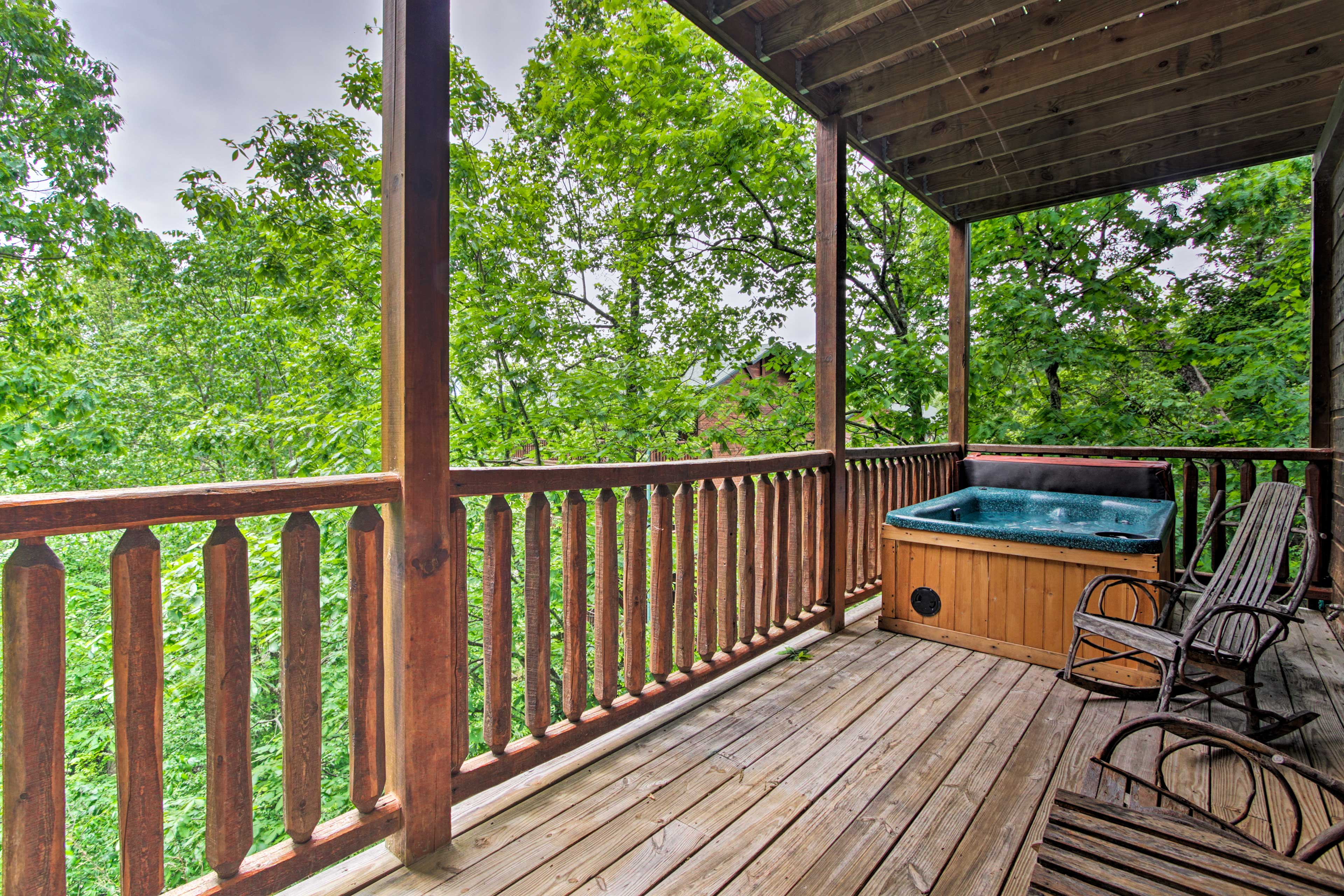 Ease sore hiking muscles in the private hot tub on the lower deck.