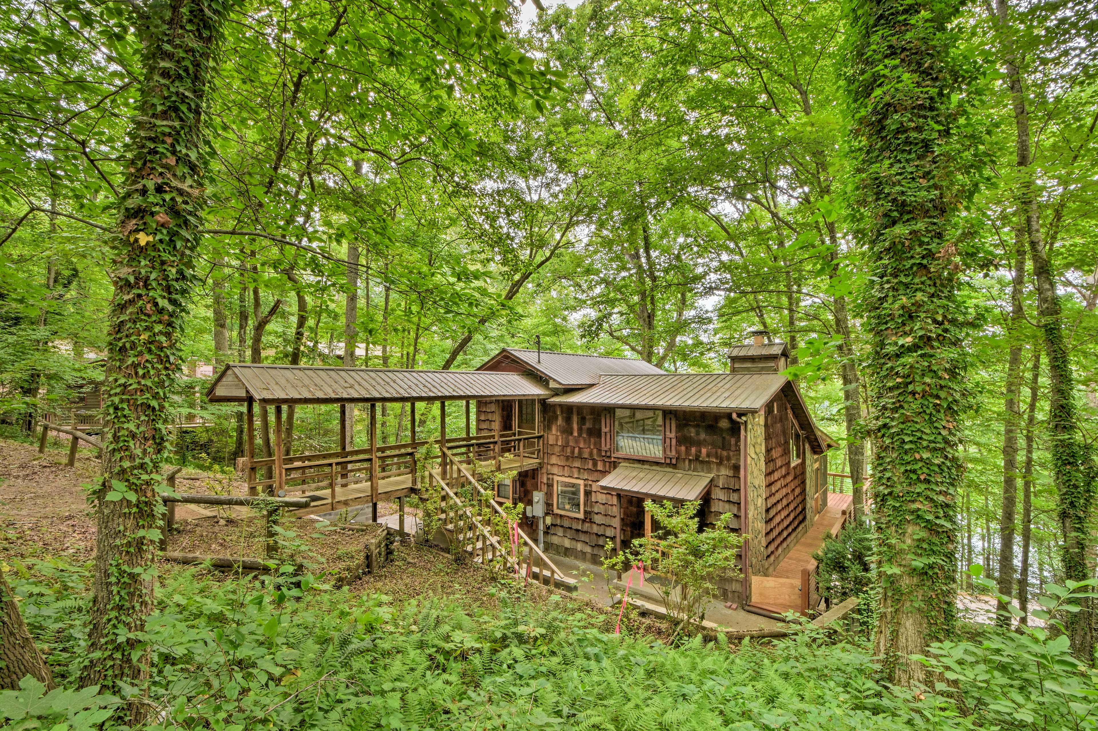 Enjoy serene surroundings at this lakeside Blue Ridge home!