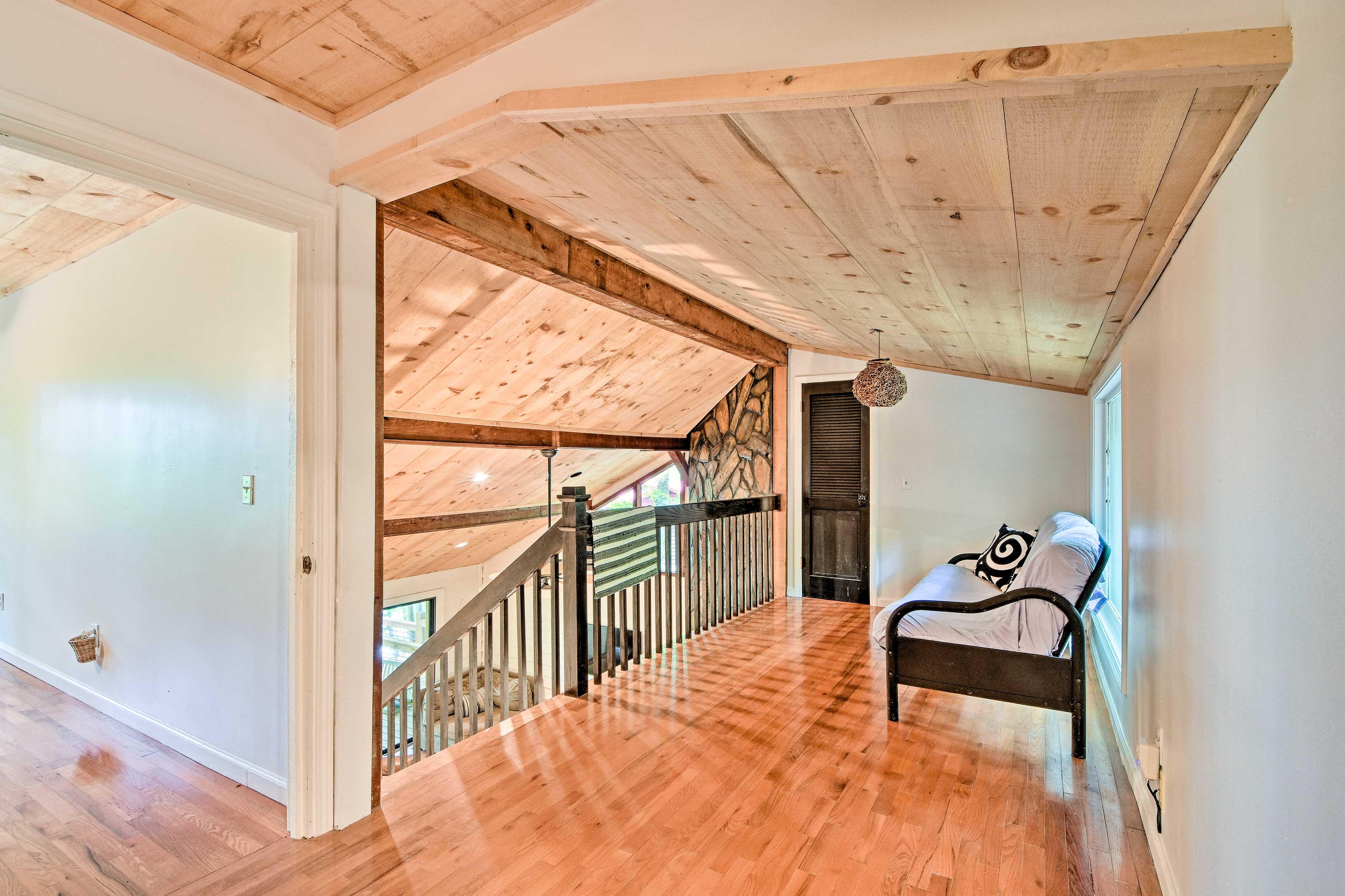 A futon can sleep 2 in the upstairs loft.