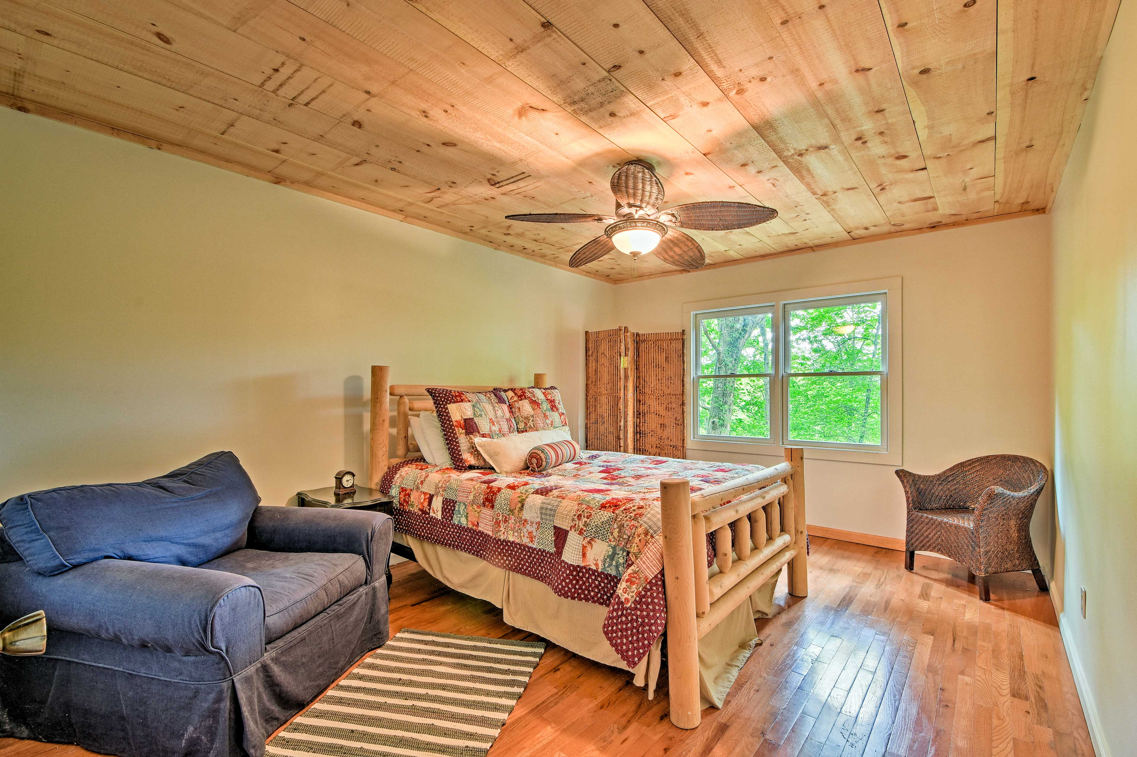 Get cozy with this bedroom's queen bed and armchair!