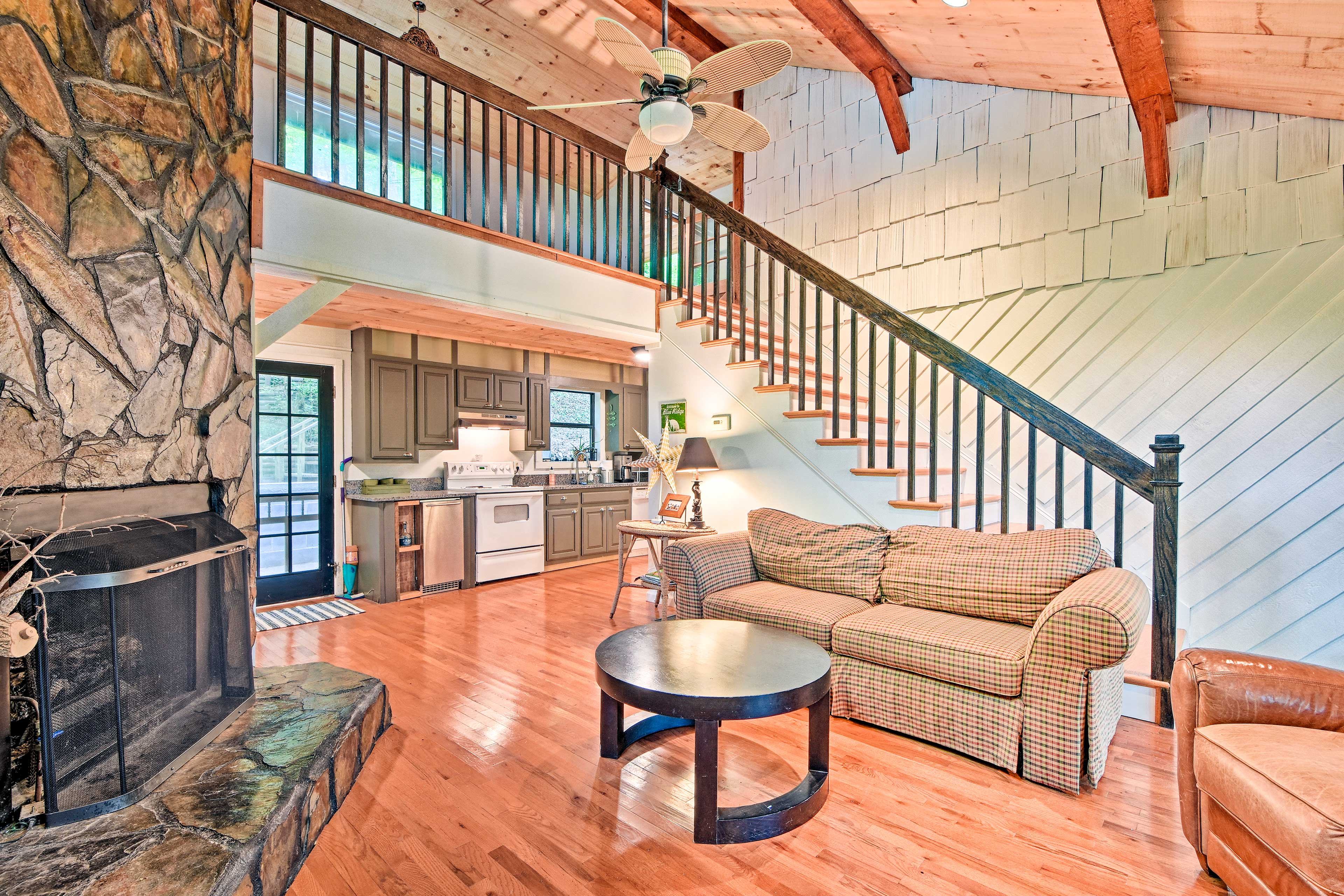 The space has high, exposed-beam ceilings and an overhead loft.