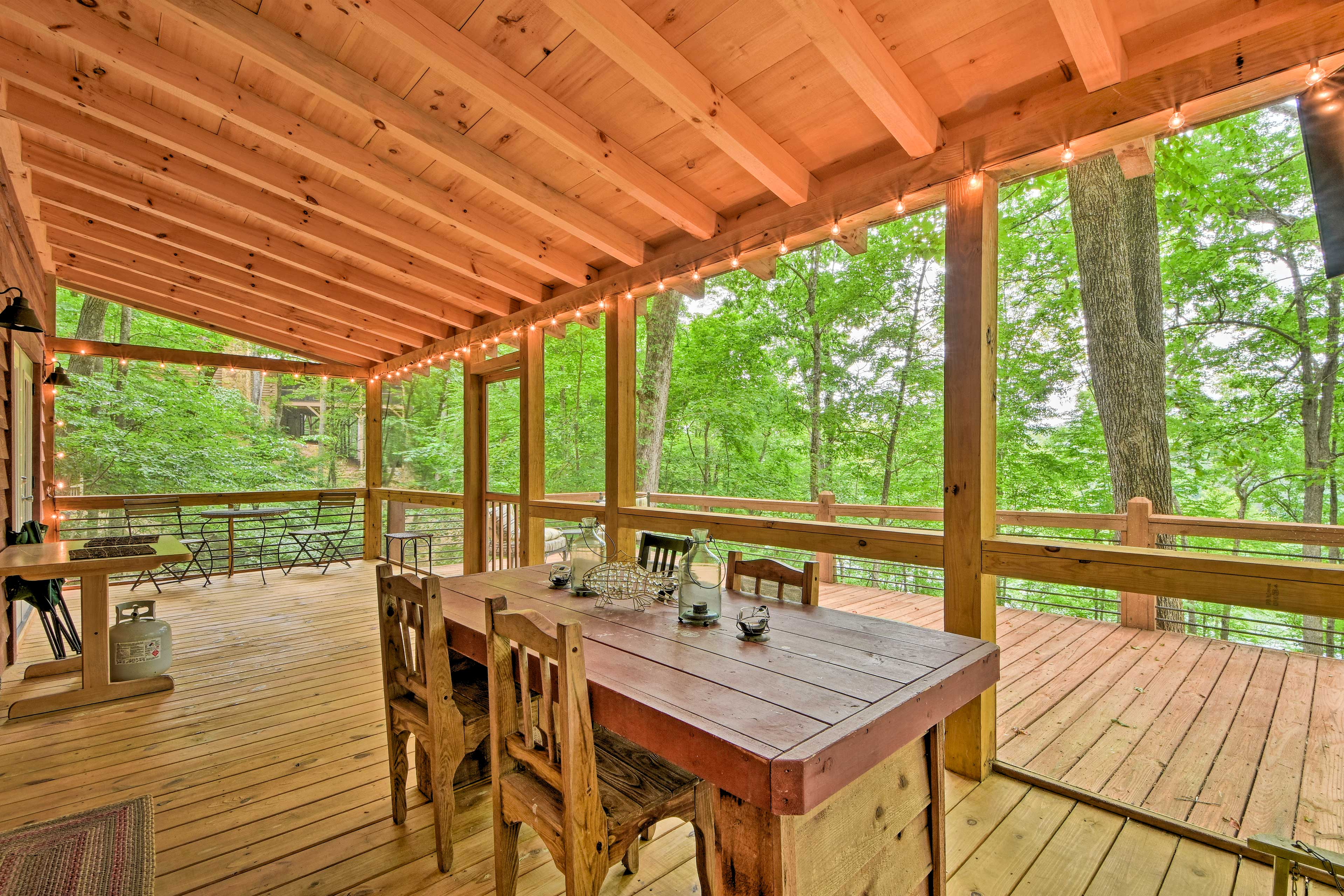 Spend evenings dining on the screened porch overlooking the forest & lake.