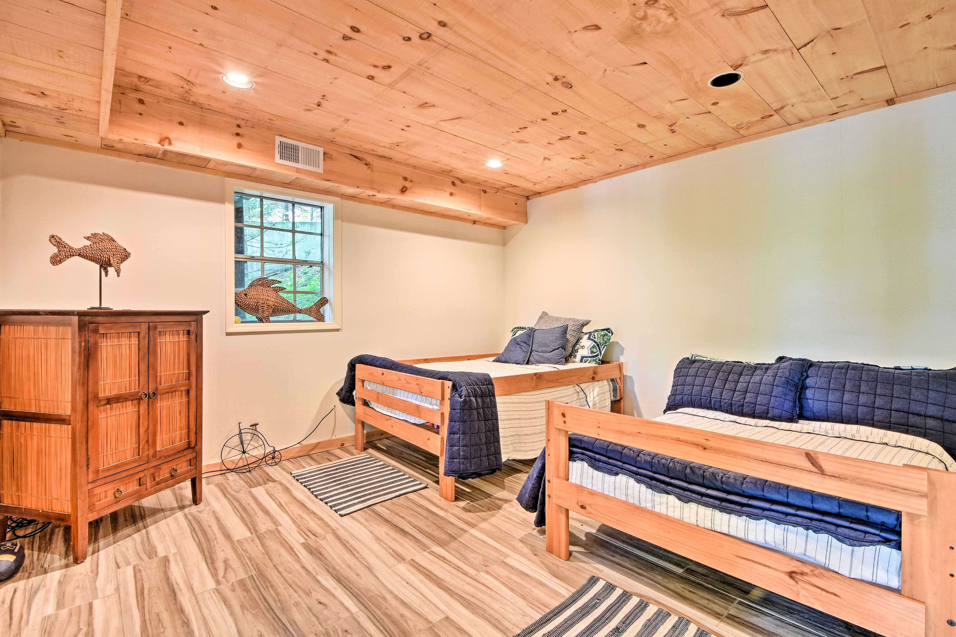 Two full-sized beds can sleep 4 guests.