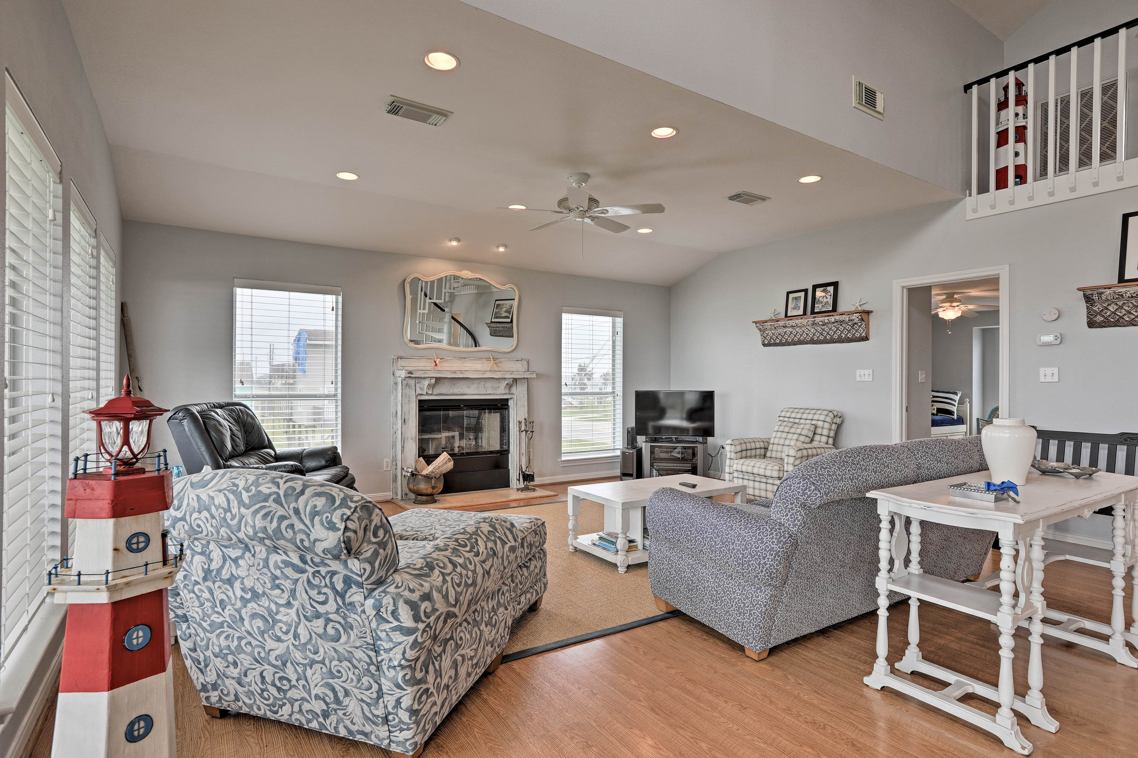 Inside, you'll find comforts like a spacious living room with a flat-screen TV.