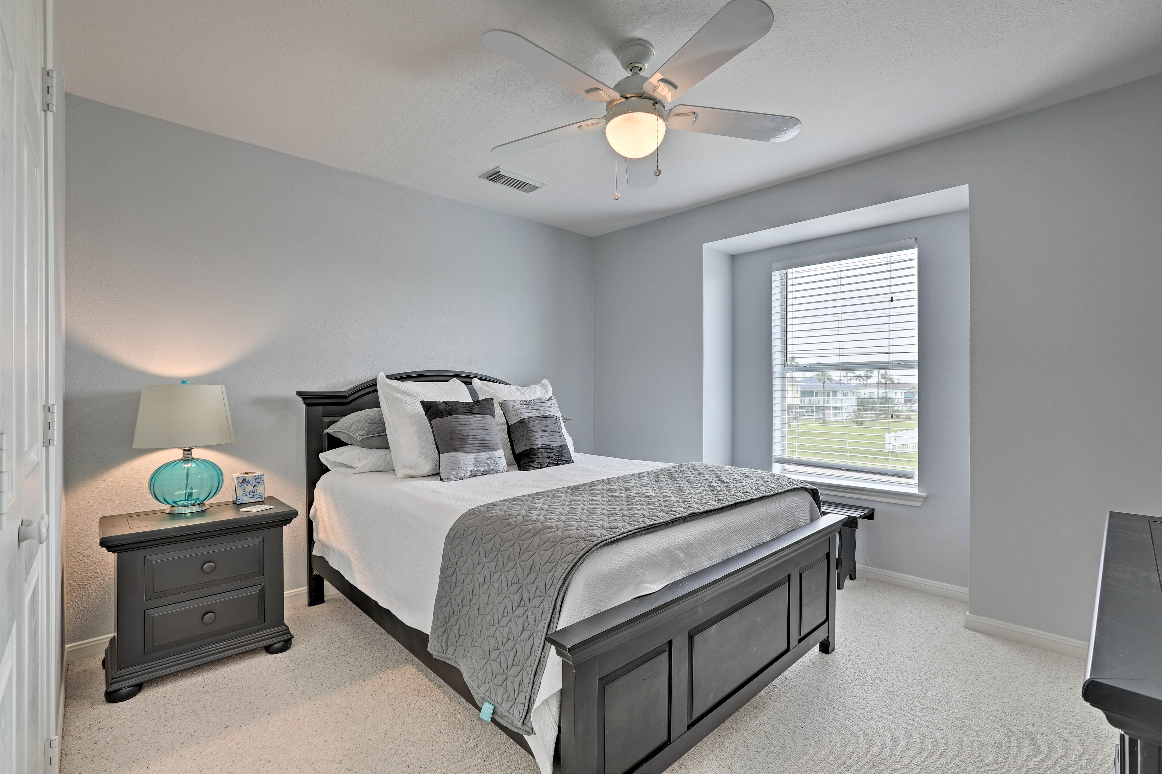 The second bedroom also features a queen-sized bed, ceiling fan, and closet.