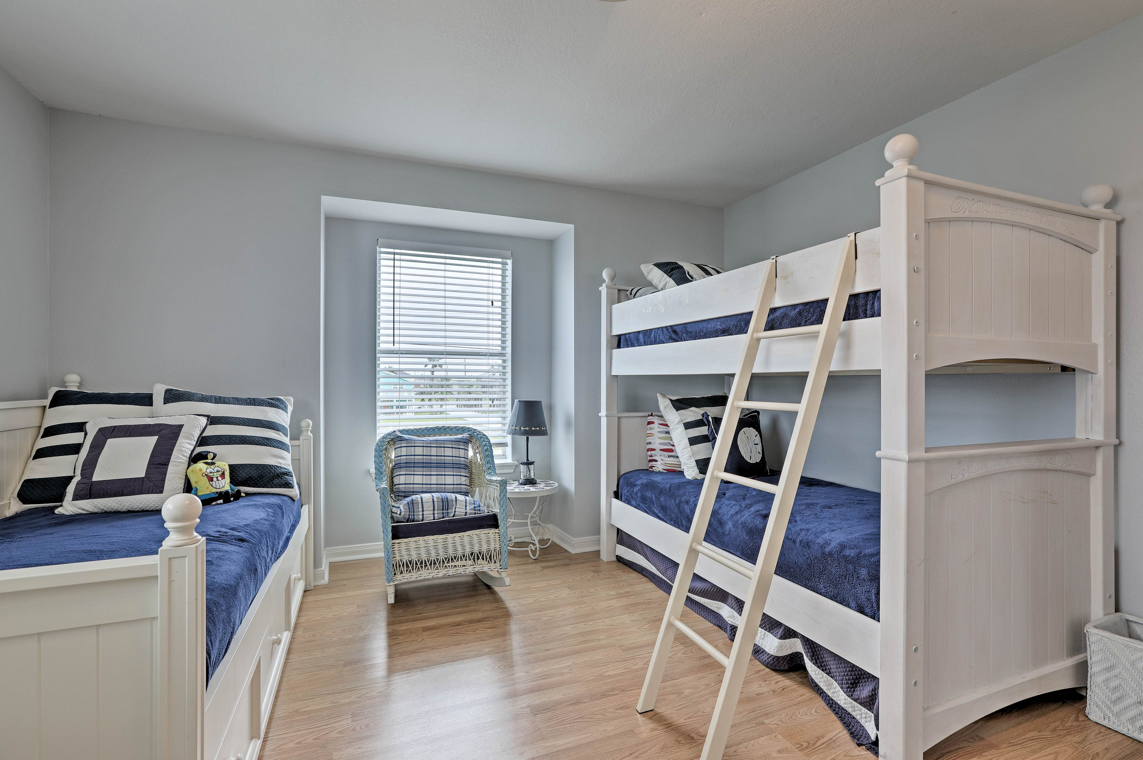 It features 2 twin beds with twin trundle beds, along with a twin bunk bed.