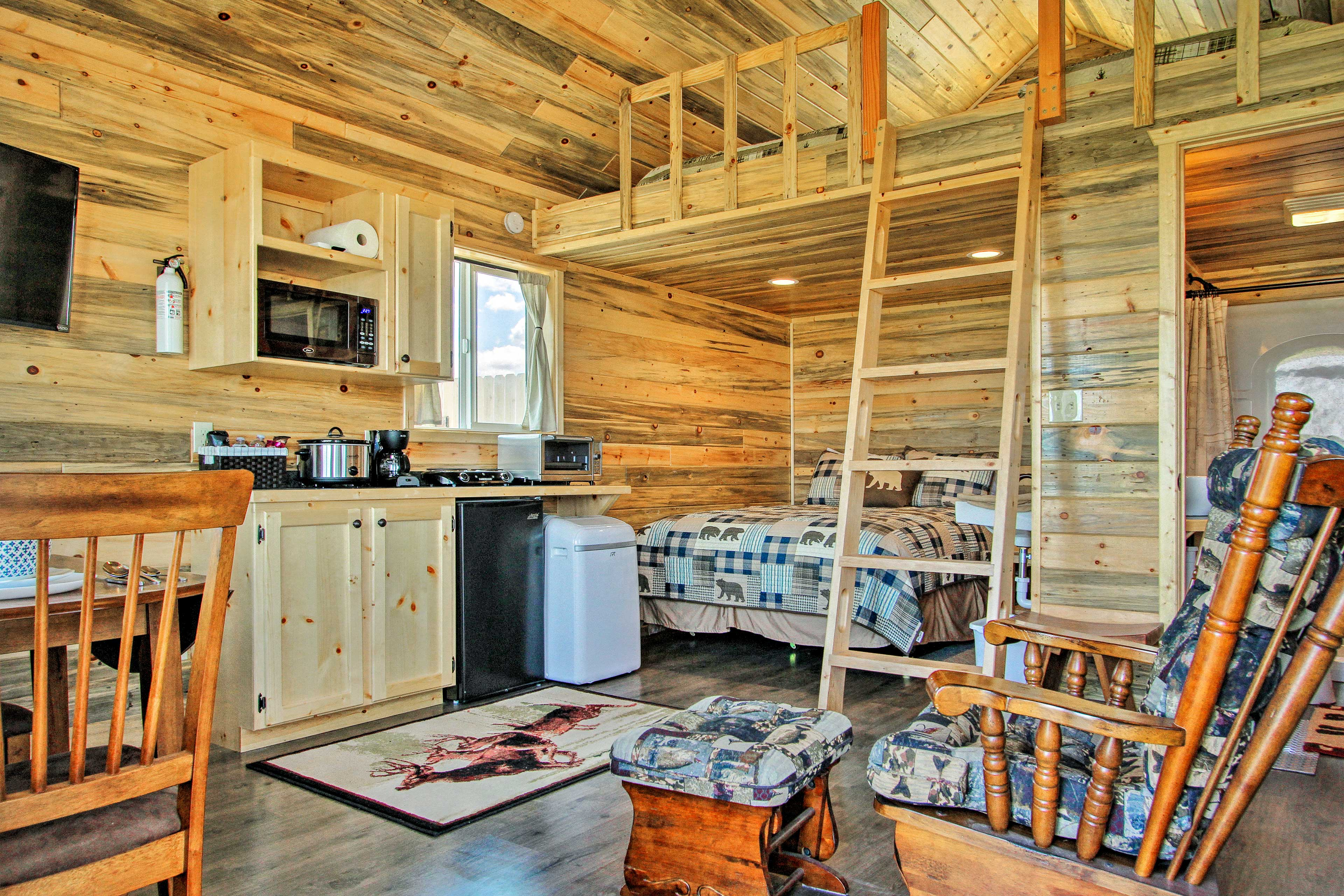 The 250 square feet feel more spacious with vaulted ceilings and a loft!