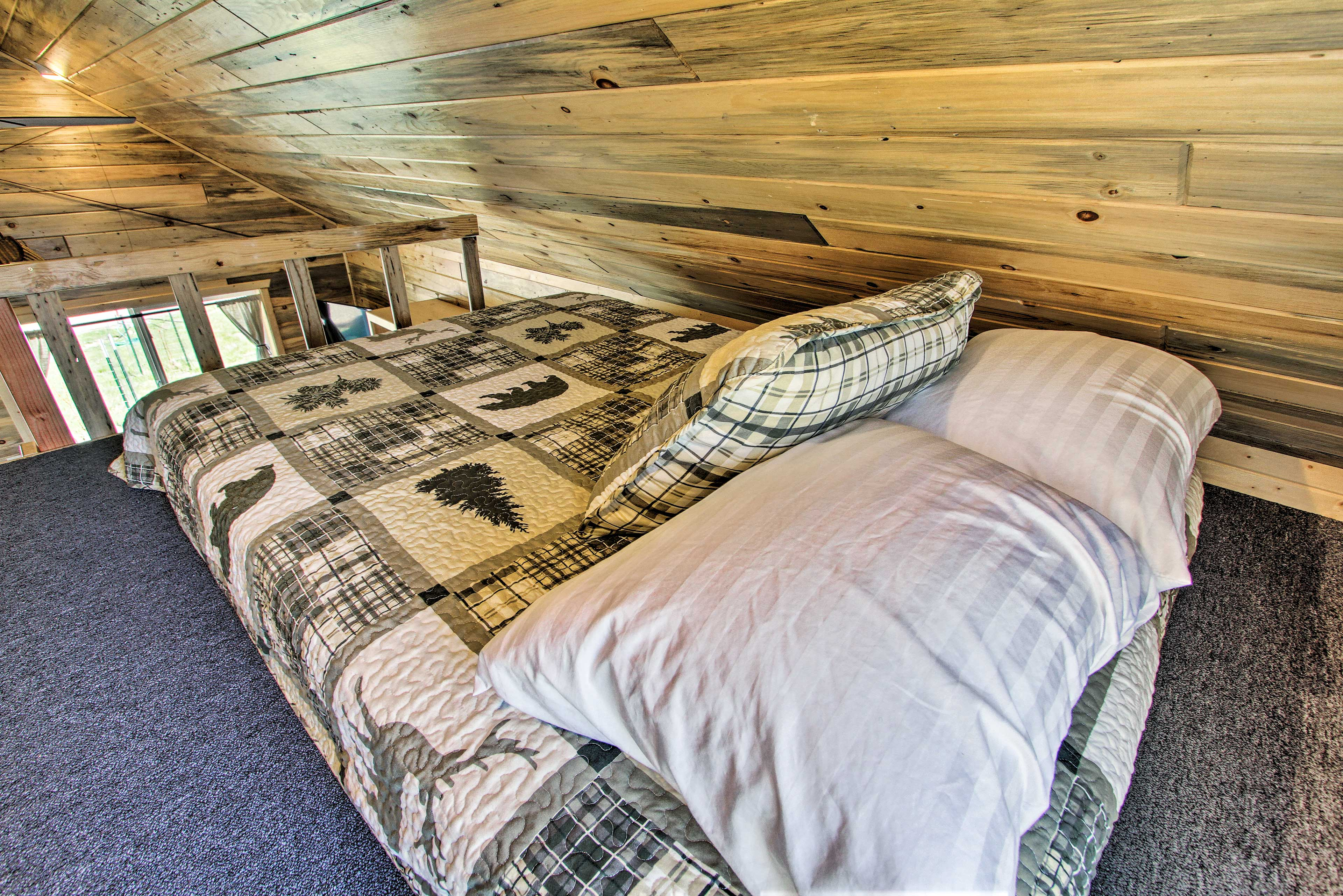 The loft features a full bed and twin bed.