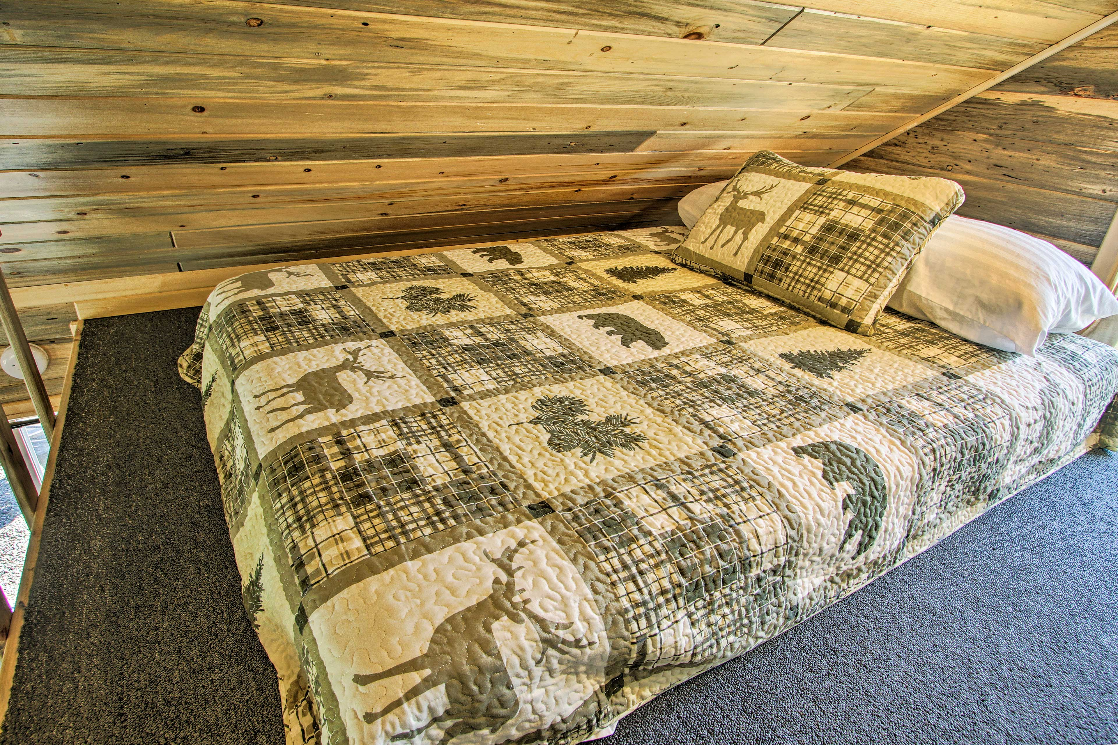 Two guests can sleep on the full bed, with one on the twin bed.
