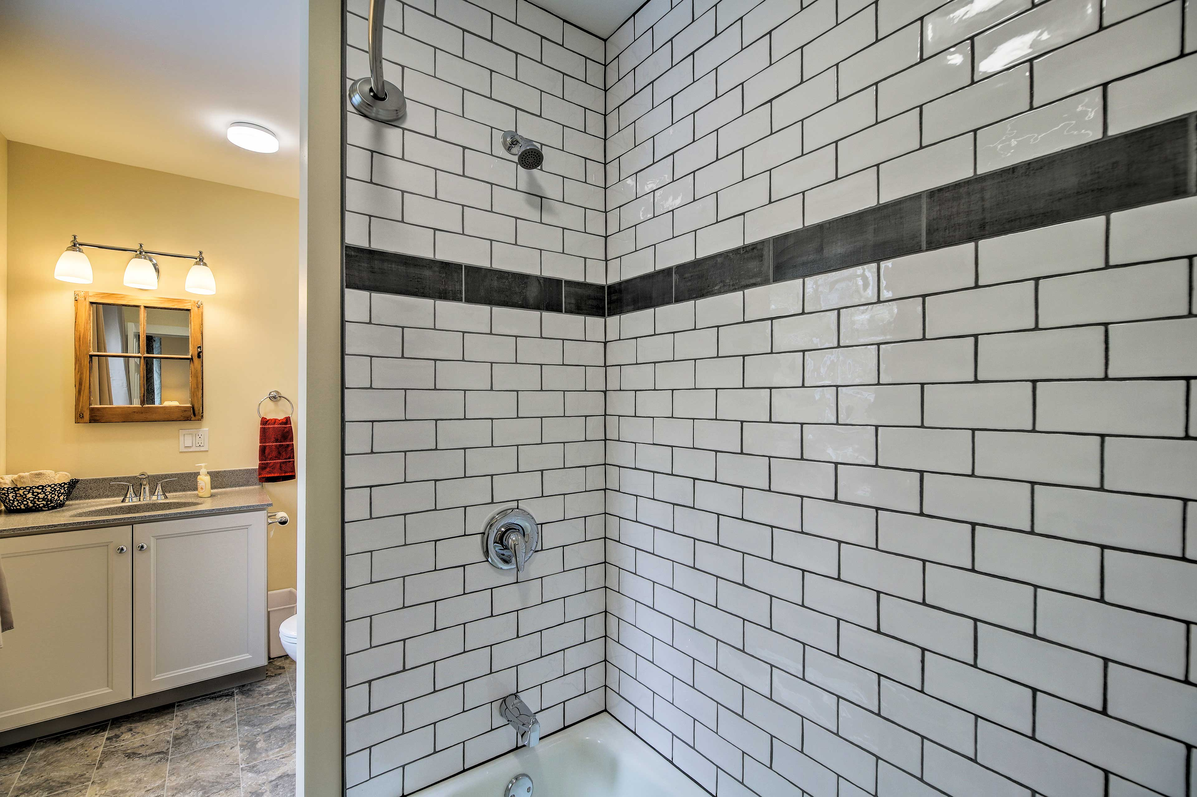 Rinse off the day in the shower of this full bathroom.