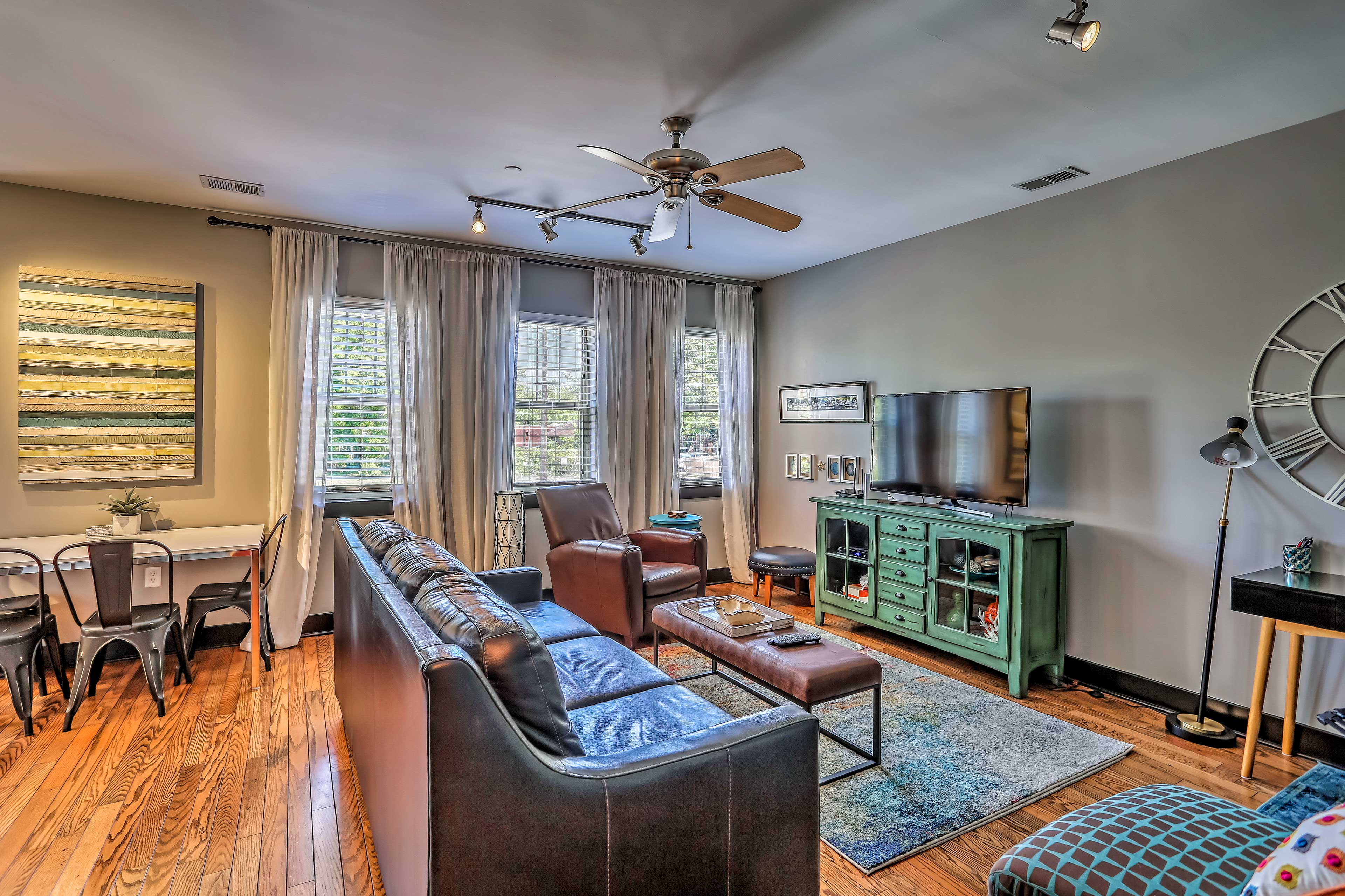 The living area features a flat screen cable TV.