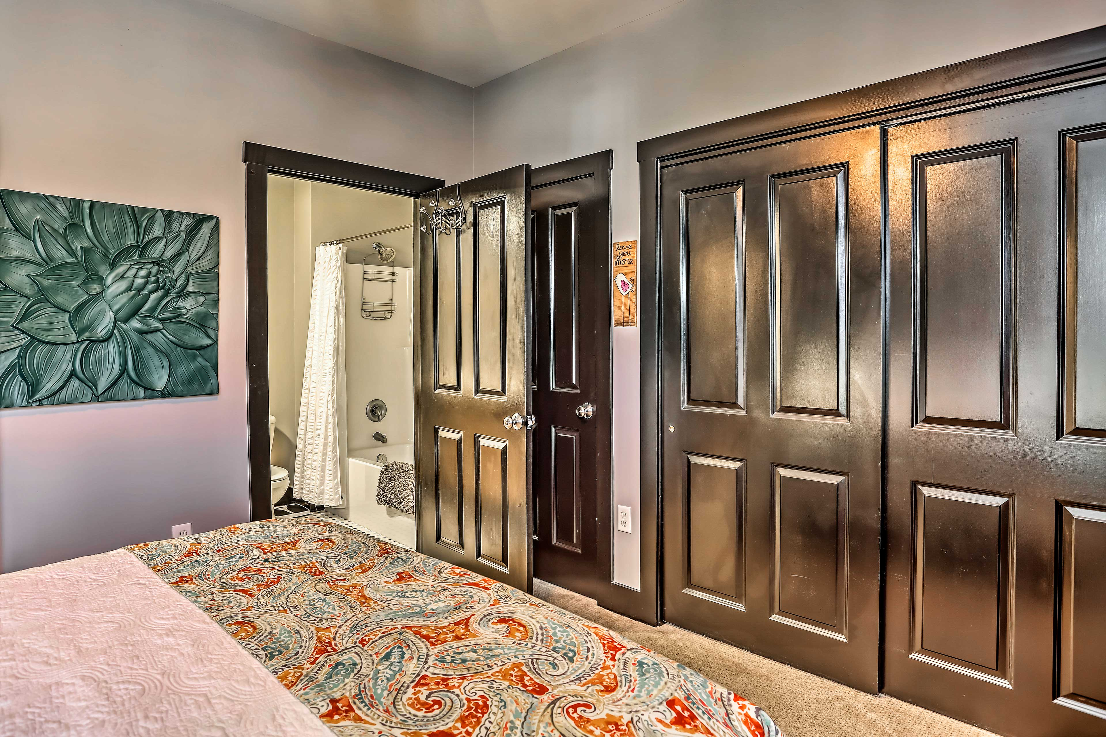 The room features an en-suite bathroom and ample closet space.