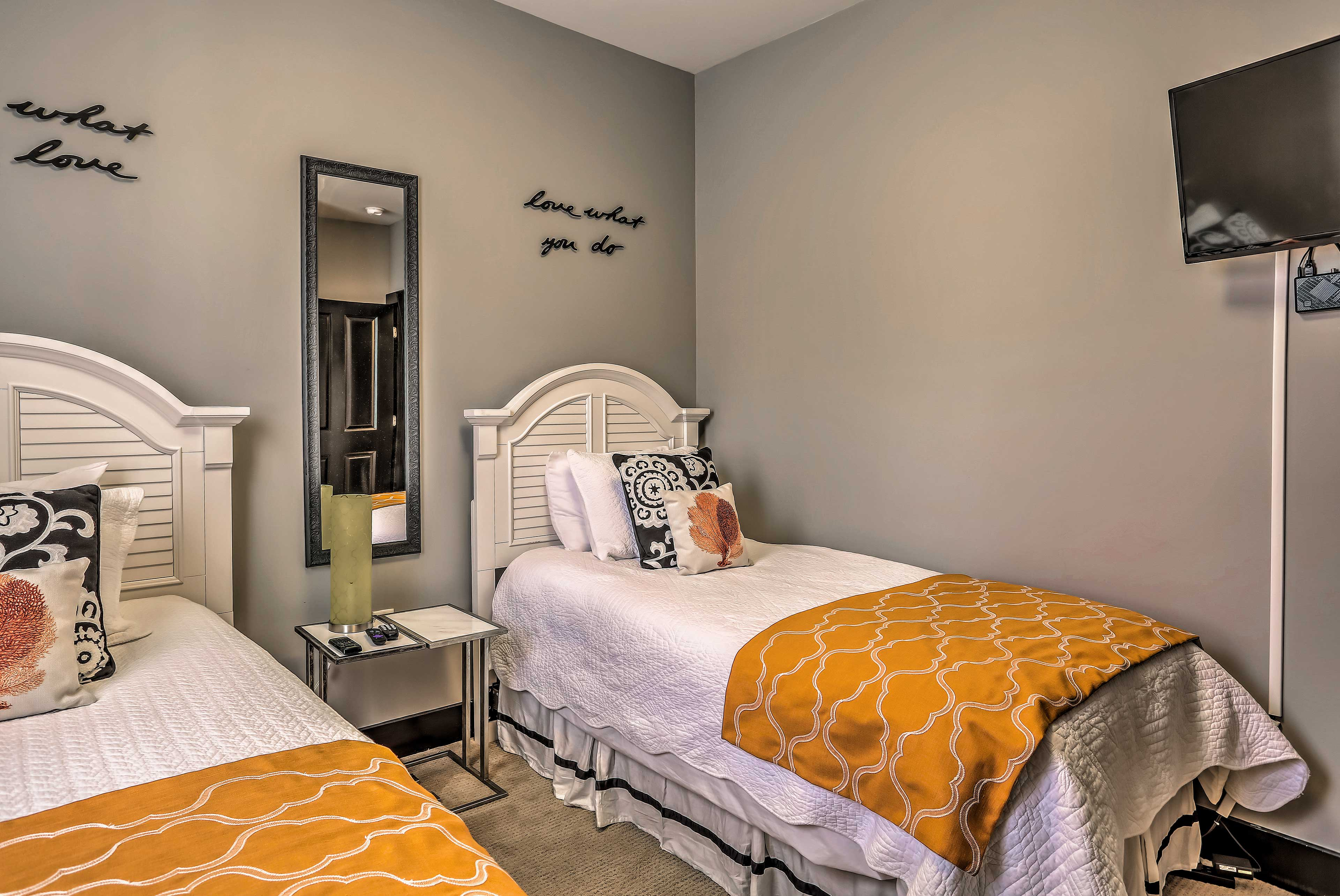 Guests in this bedroom will be able to fall asleep to their favorite shows!