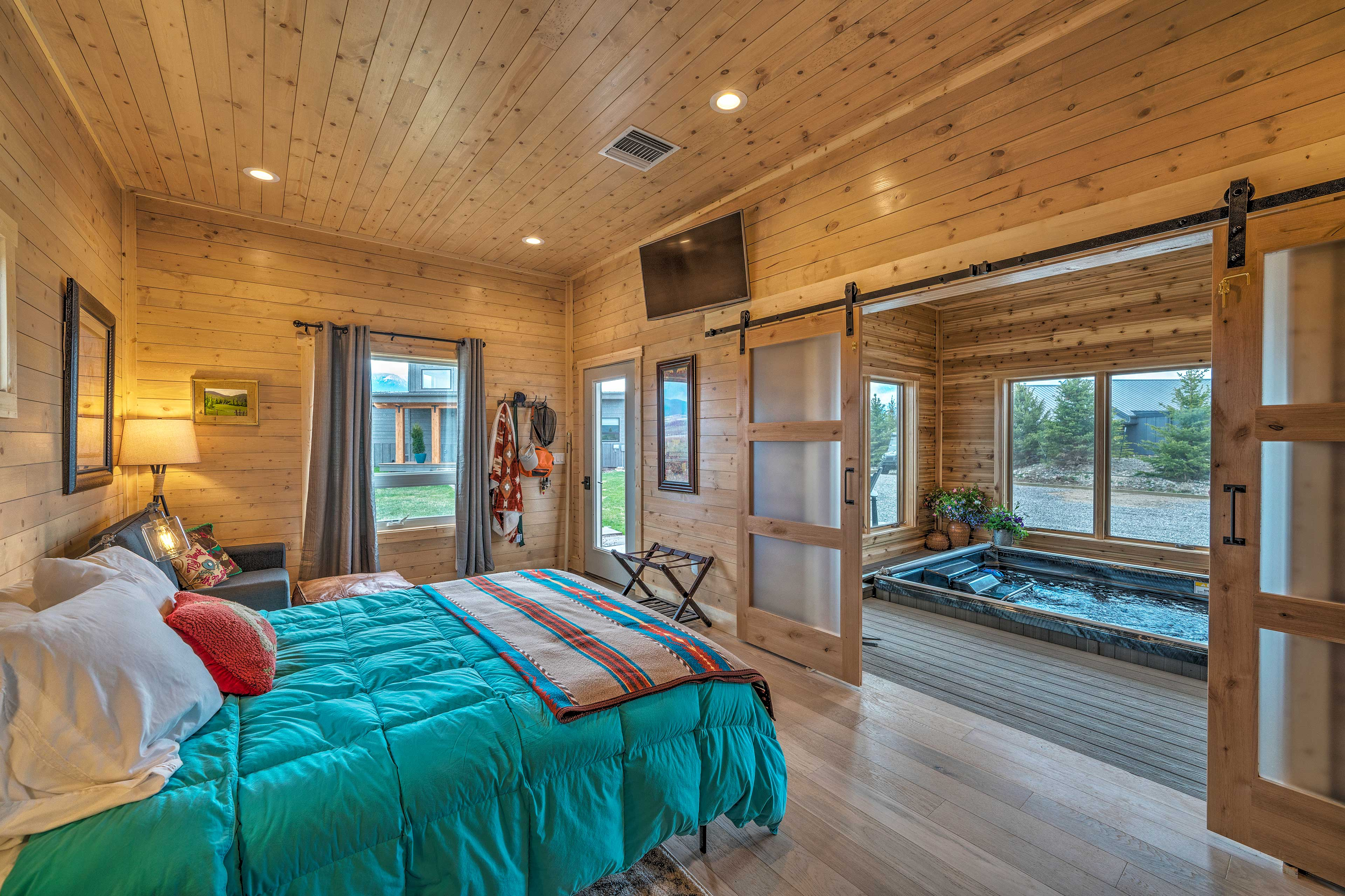 Sliding barn doors reveal access to the private indoor pool.