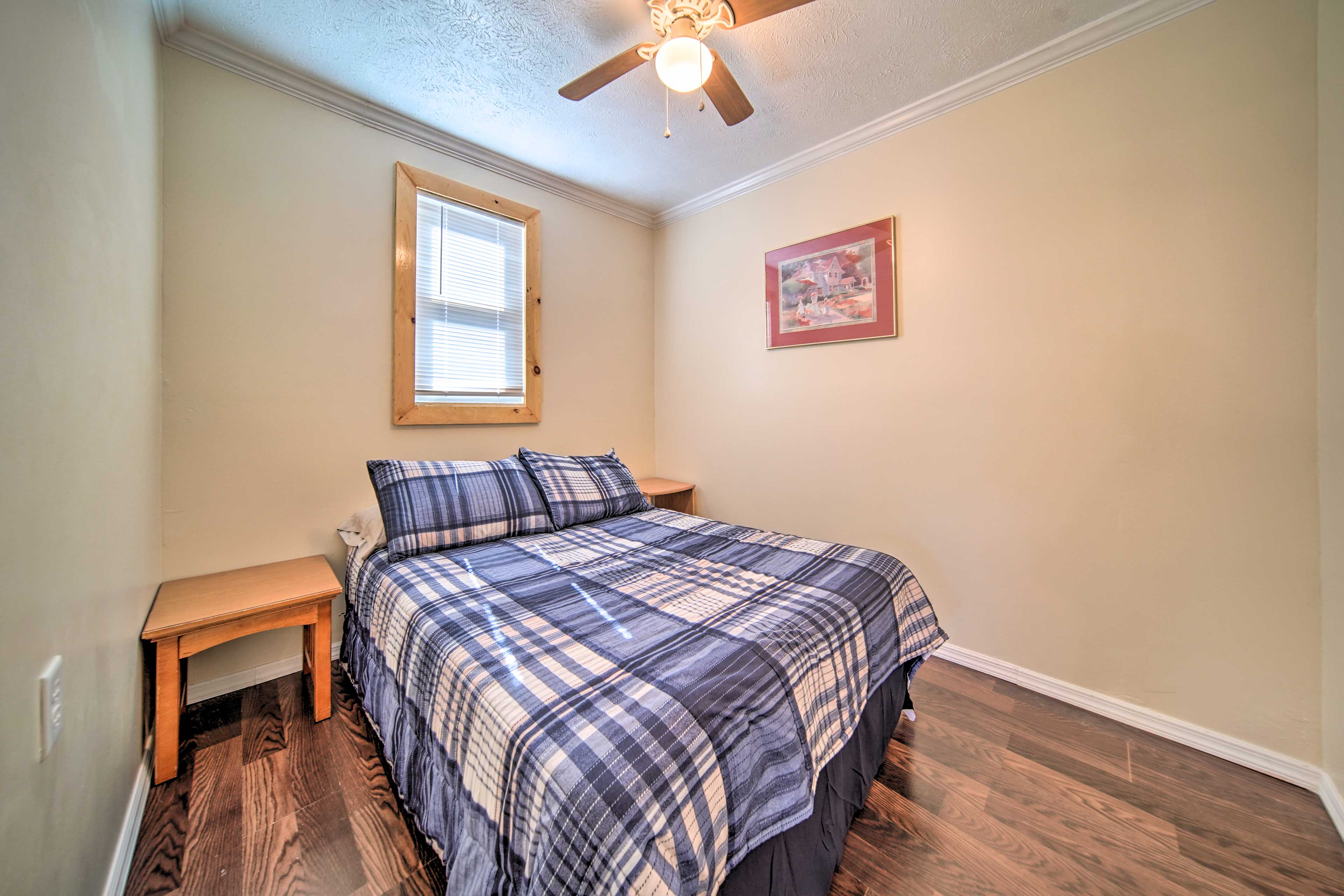 Two guests can share the comfort of this full bed.