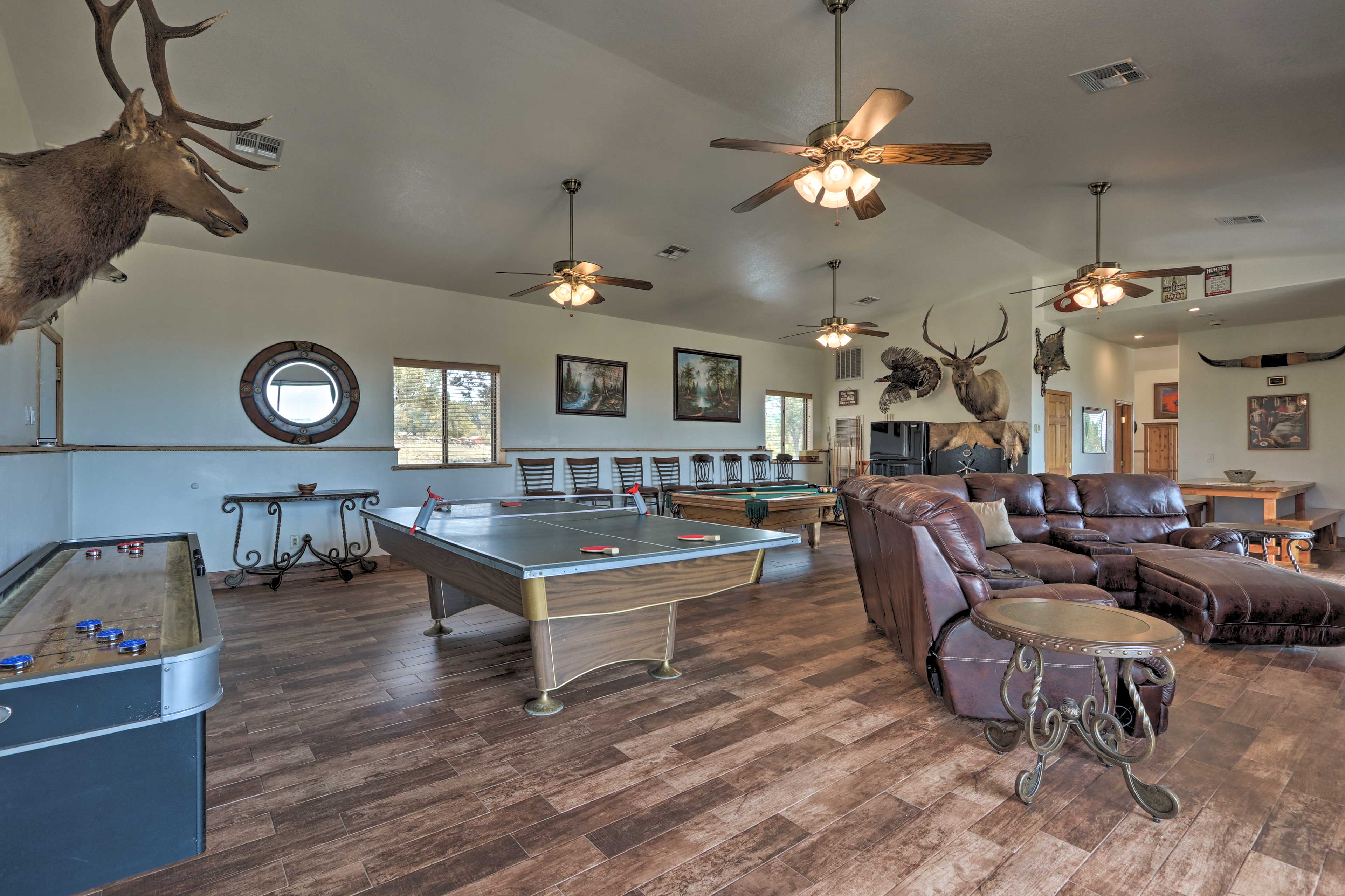 It features a pool table, flat-screen TV, and second refrigerator.