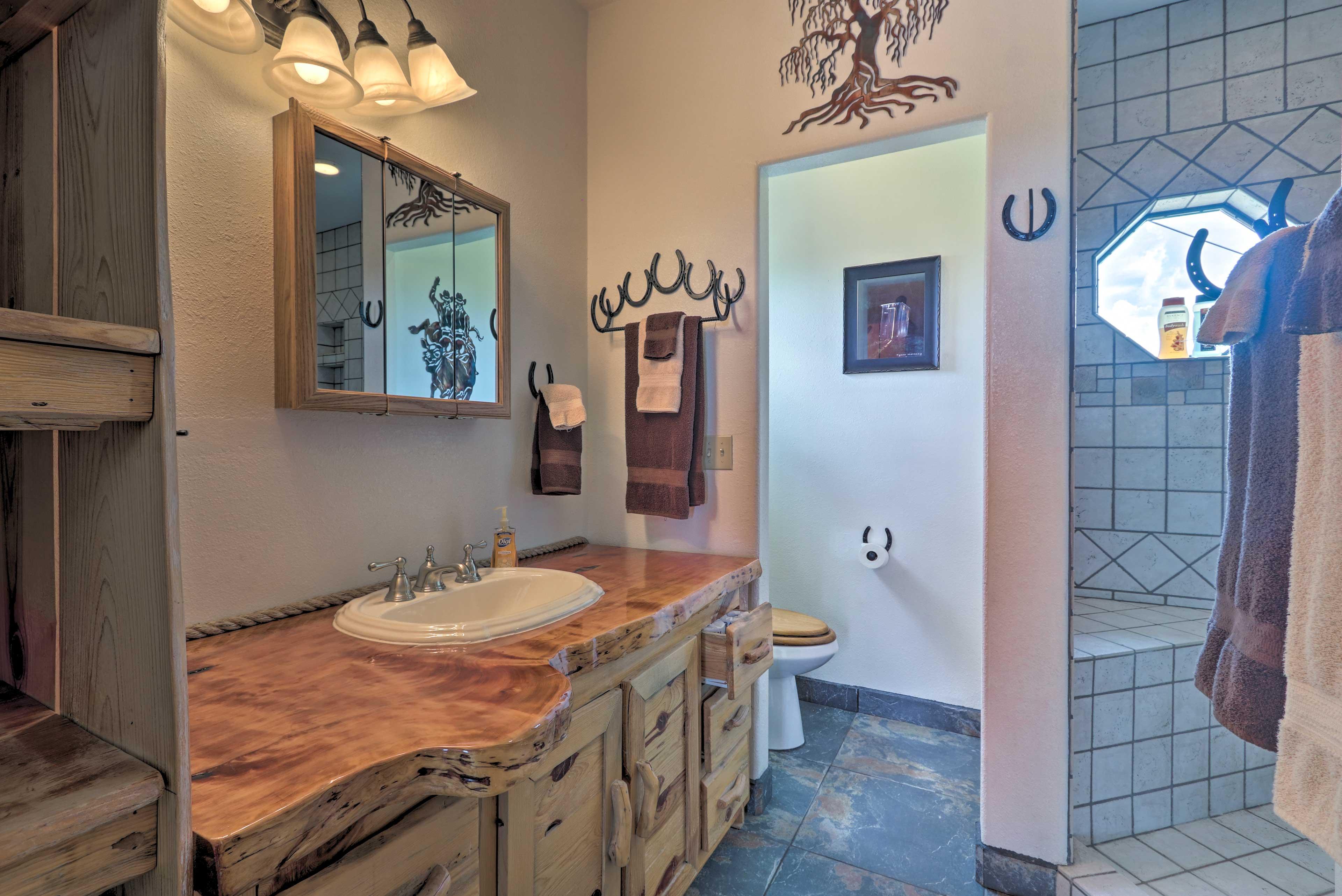Juniper slab counter & a walk-in dual head shower are master bath highlights!