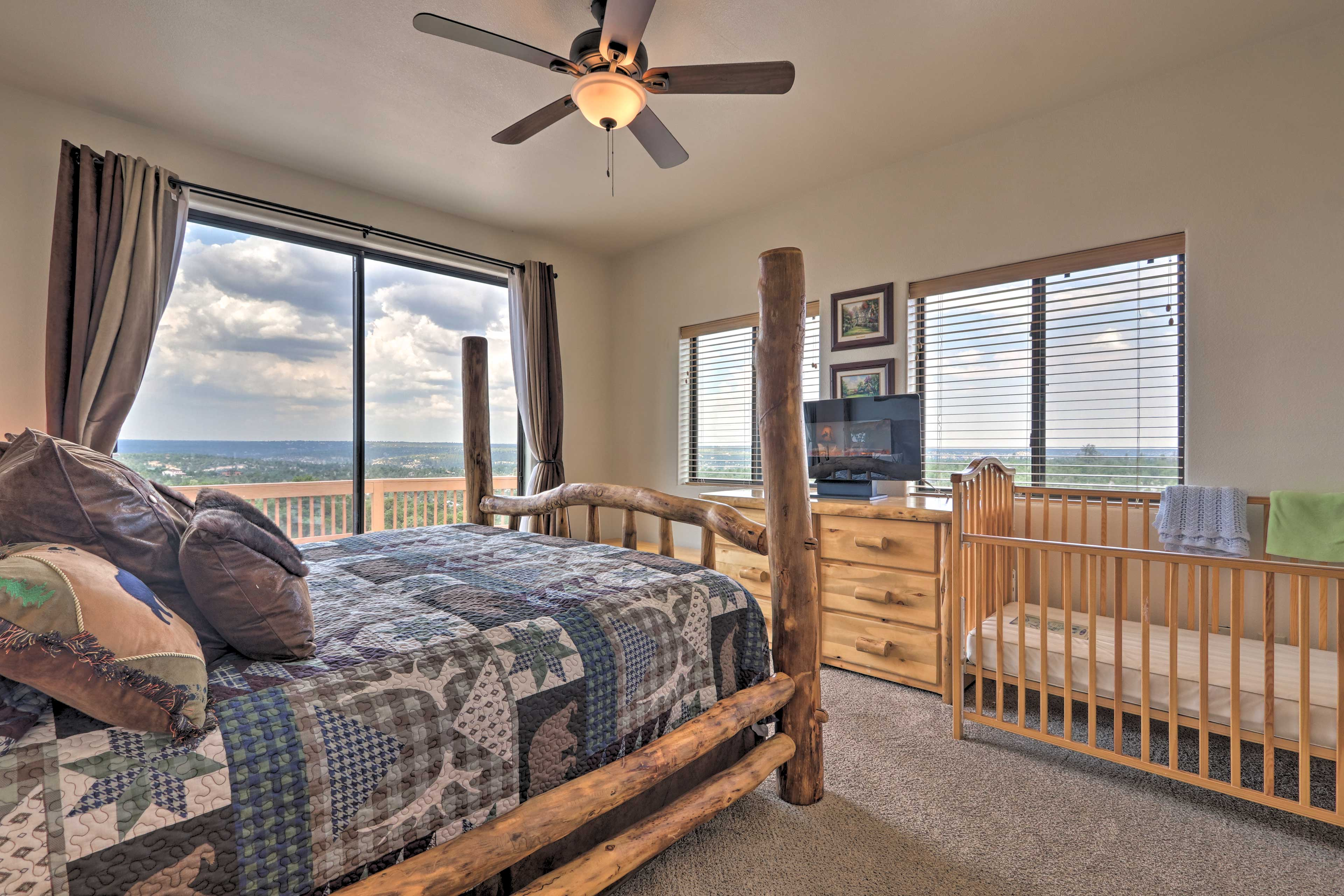 The master bedroom features a king bed along with a crib, great for families!