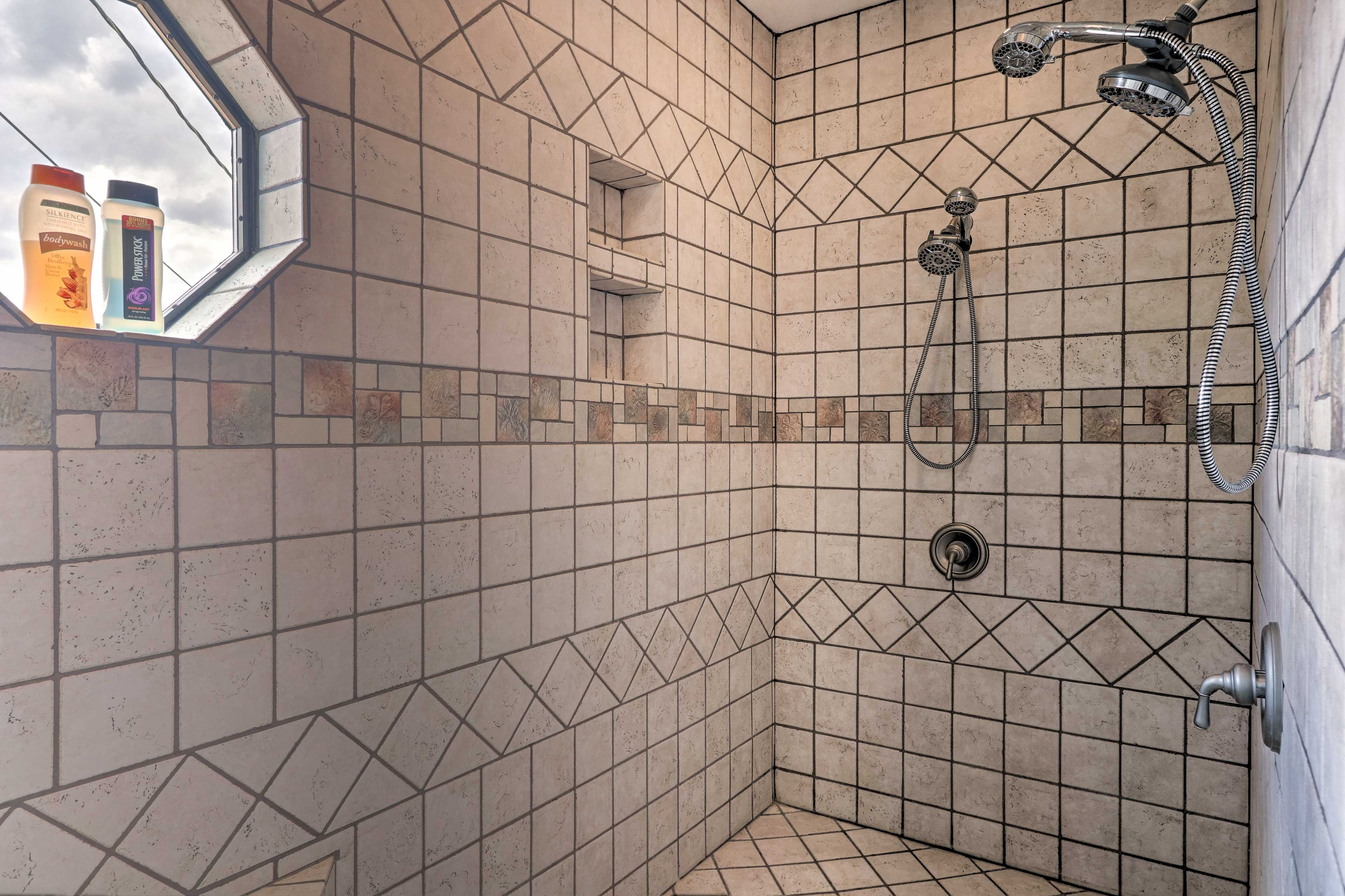 Rinse away the day in this tile-lined shower.