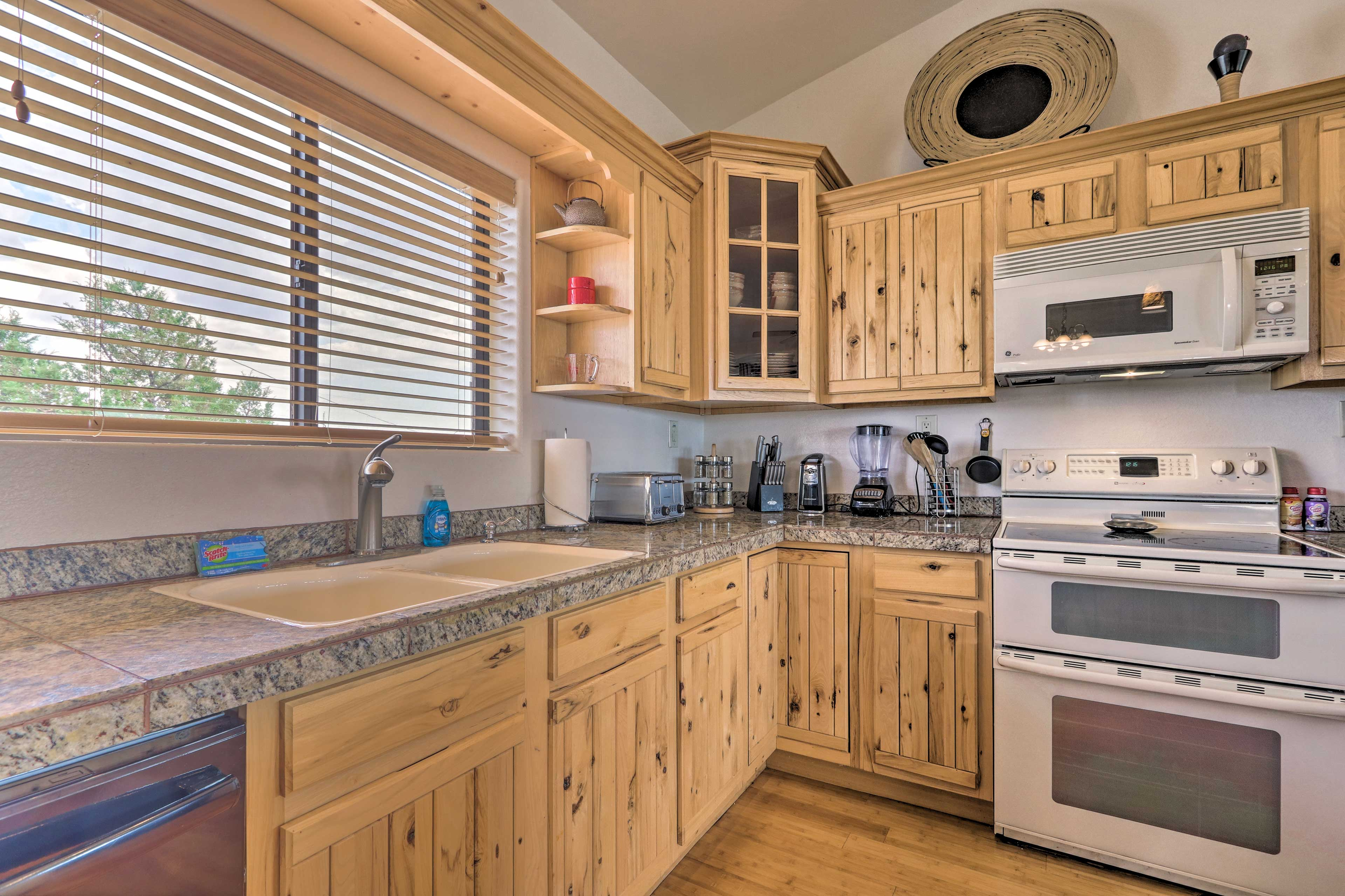 Granite countertops add a touch of luxury to your cooking experience.