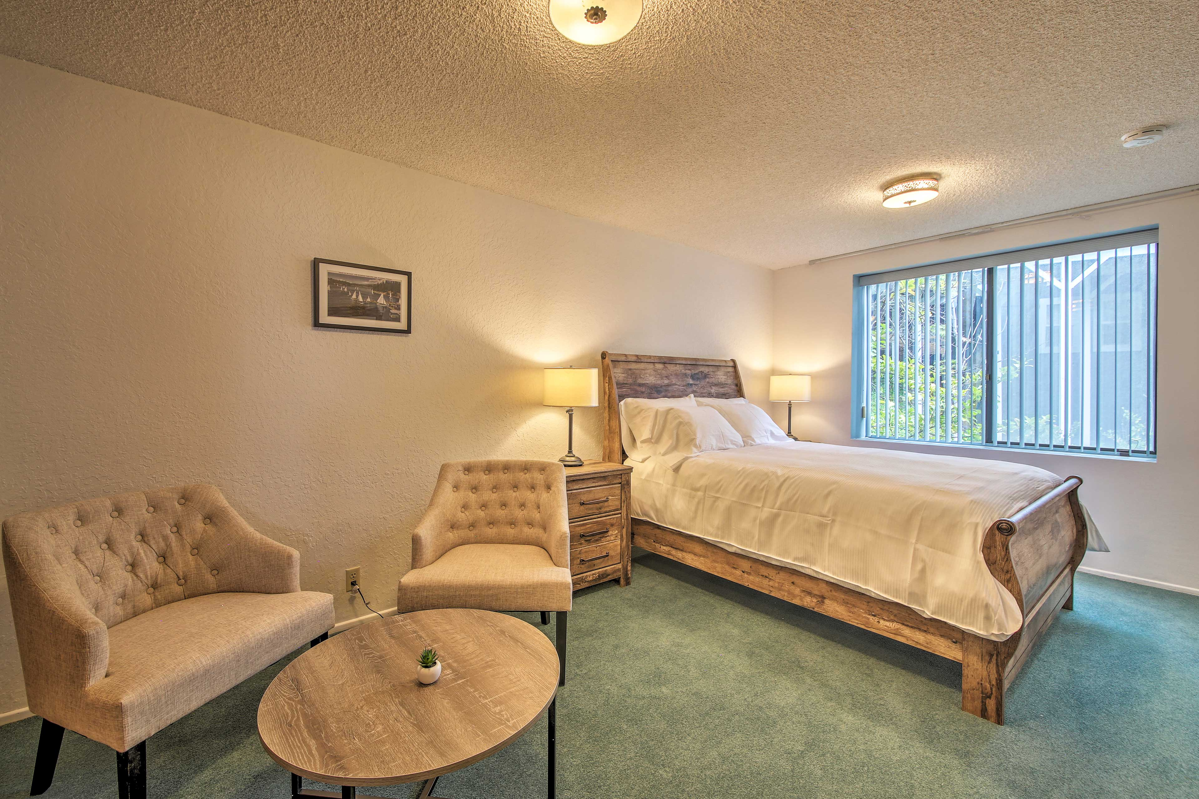 Find a queen-sized bed awaiting you in bedroom 4.