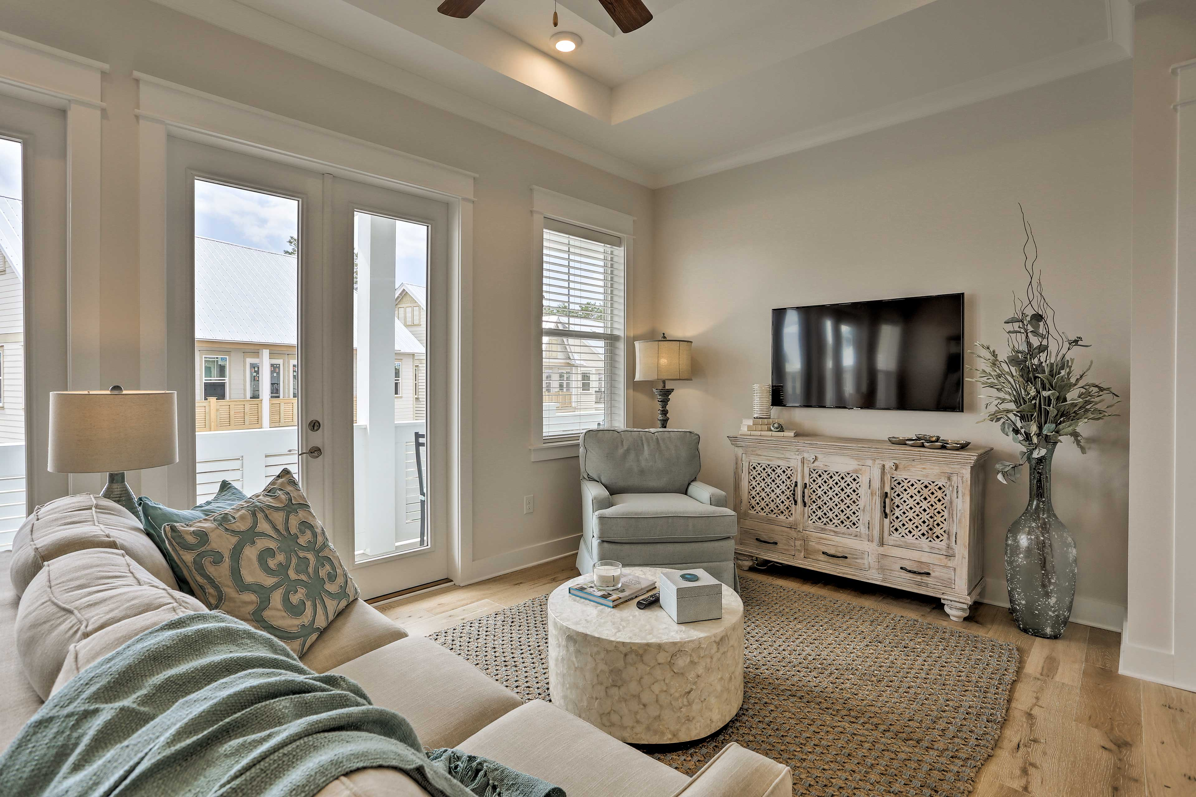 Kick back on the sofa or armchair in the living room featuring a flat-screen TV.