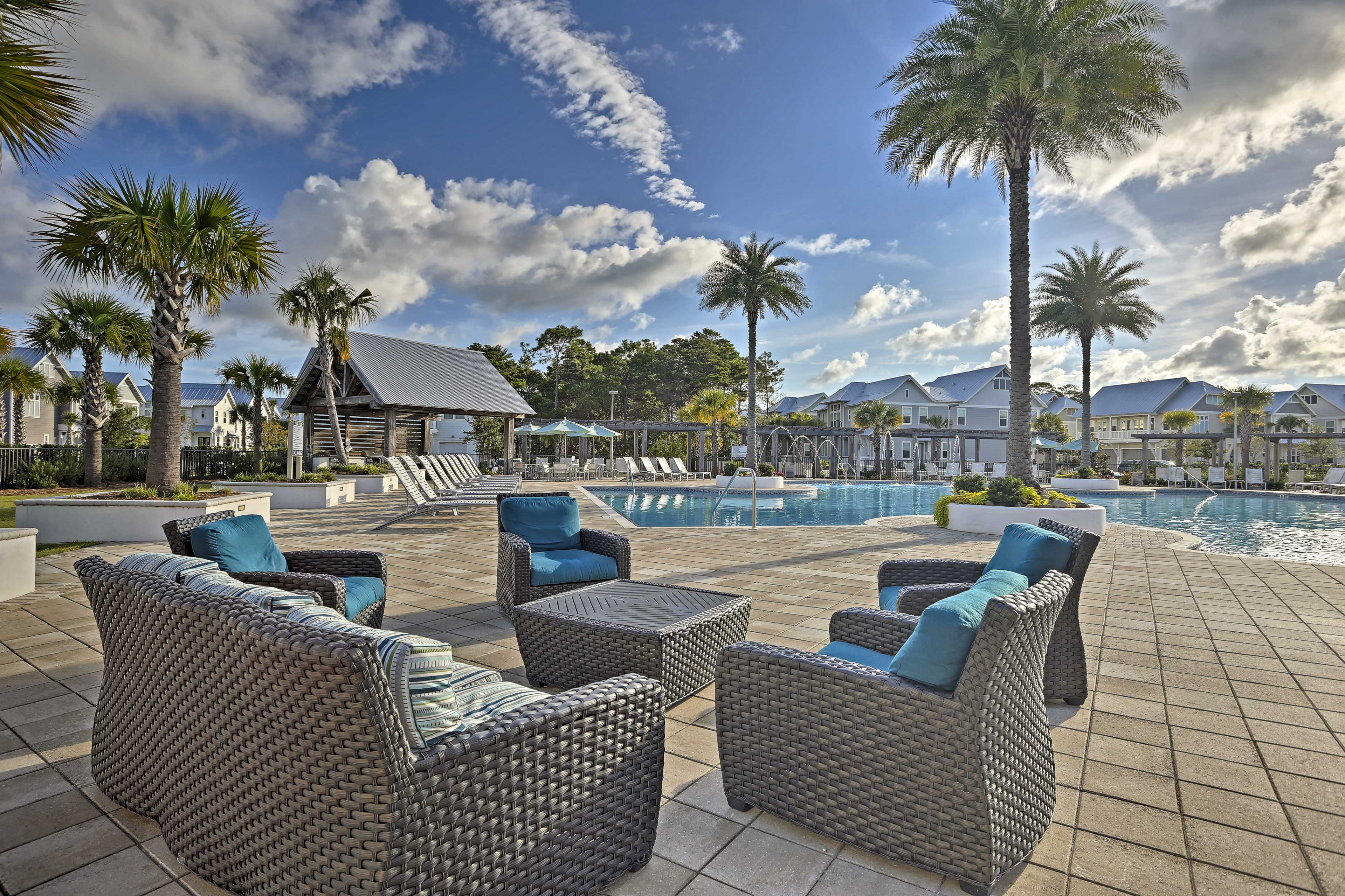 Take a seat in the patio furniture or lounge chairs around the community pool.