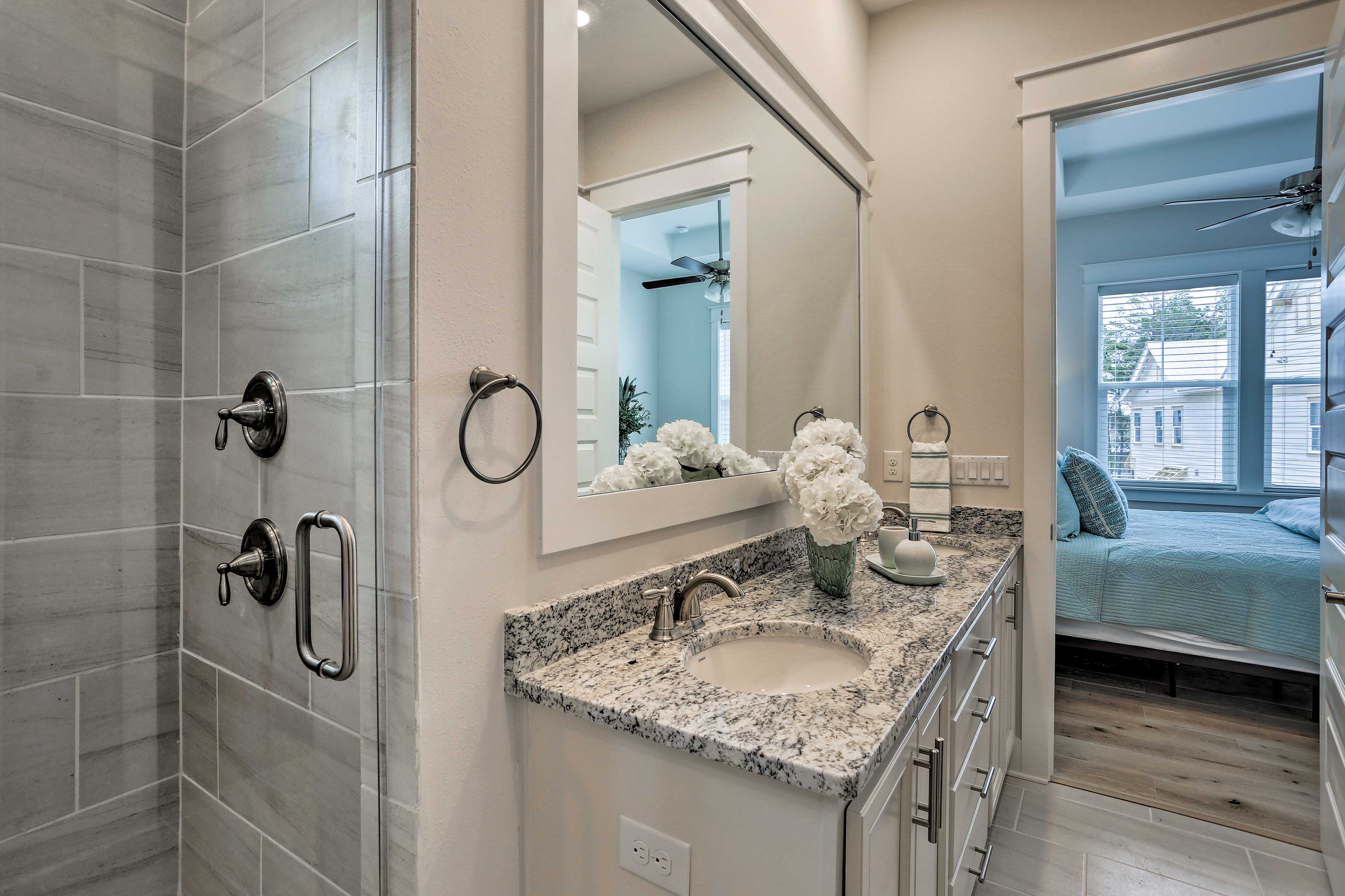 The master en-suite bathroom offers a walk-in shower and dual sinks.