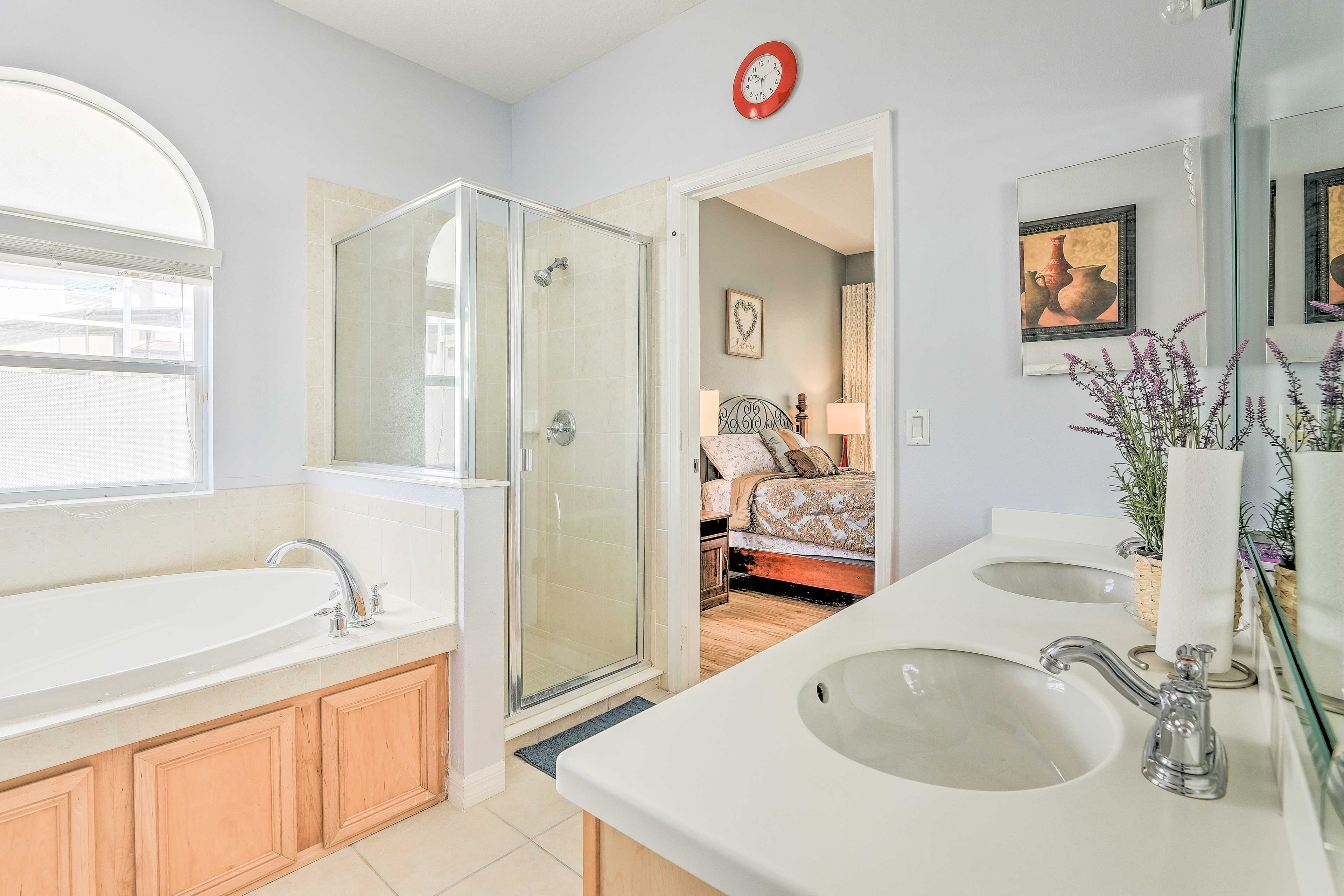 Rinse off in the walk-in shower or take a relaxing soak in the large tub.