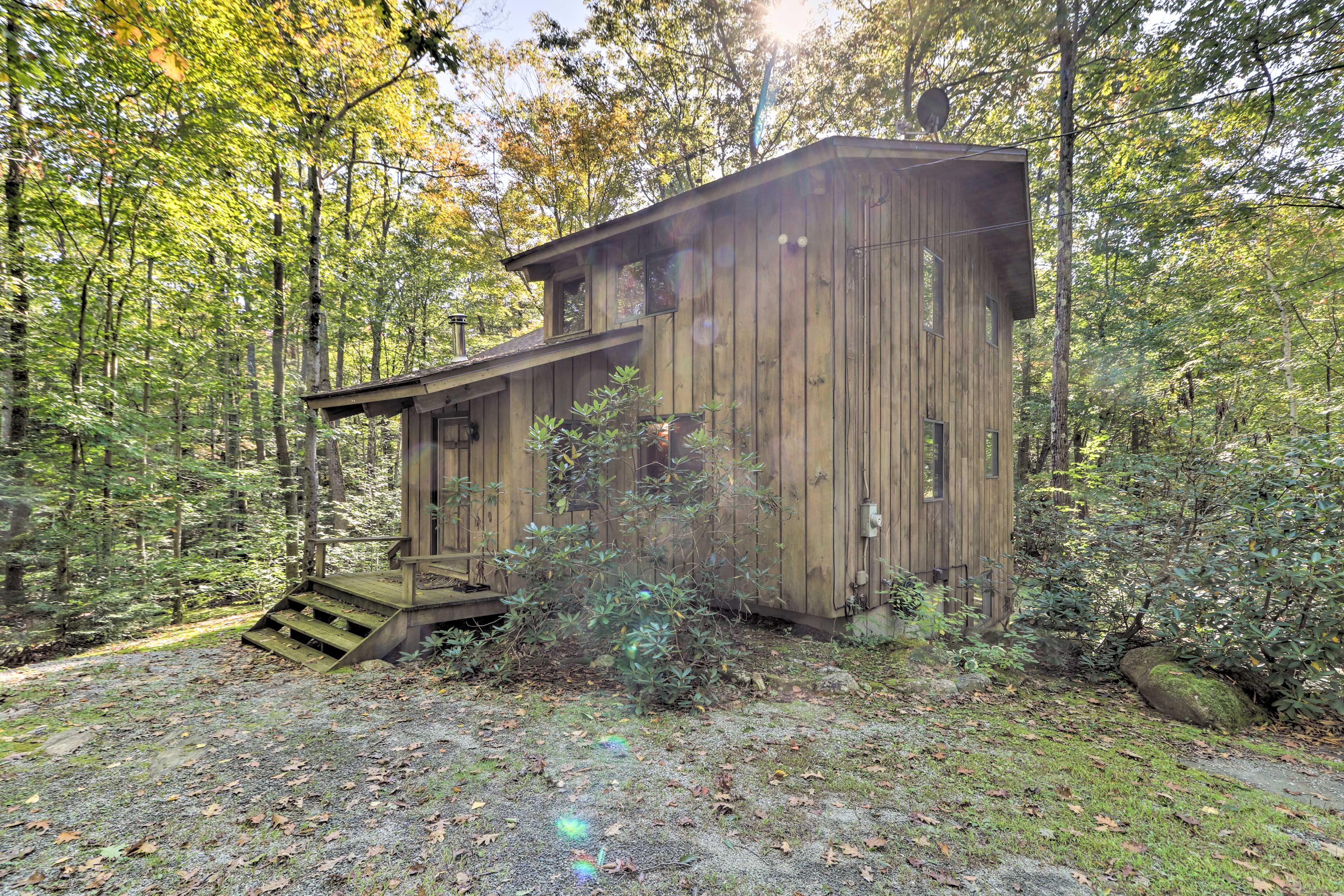This cabin is hidden away on 2 private acres.