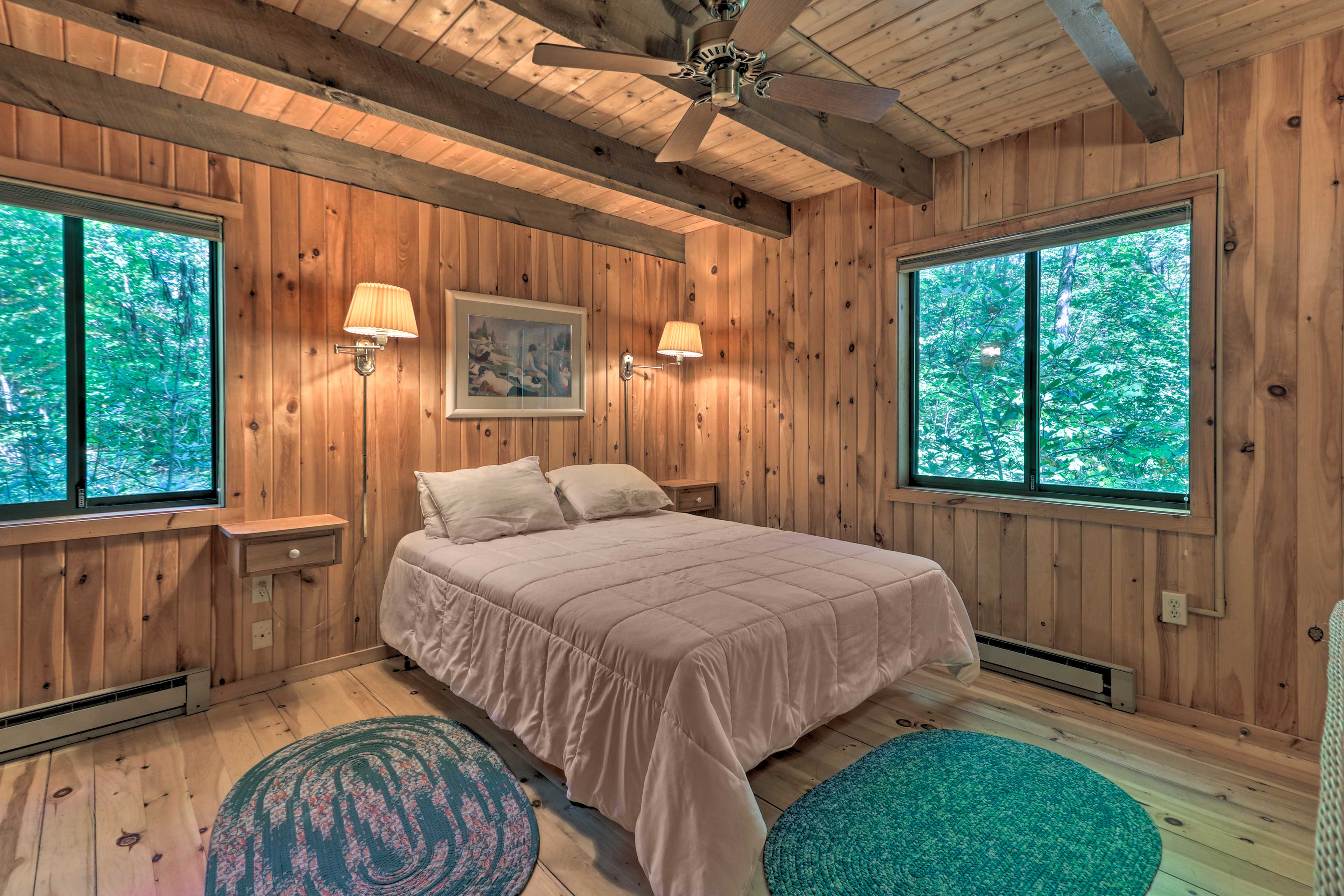The second bedroom features a queen bed as well.