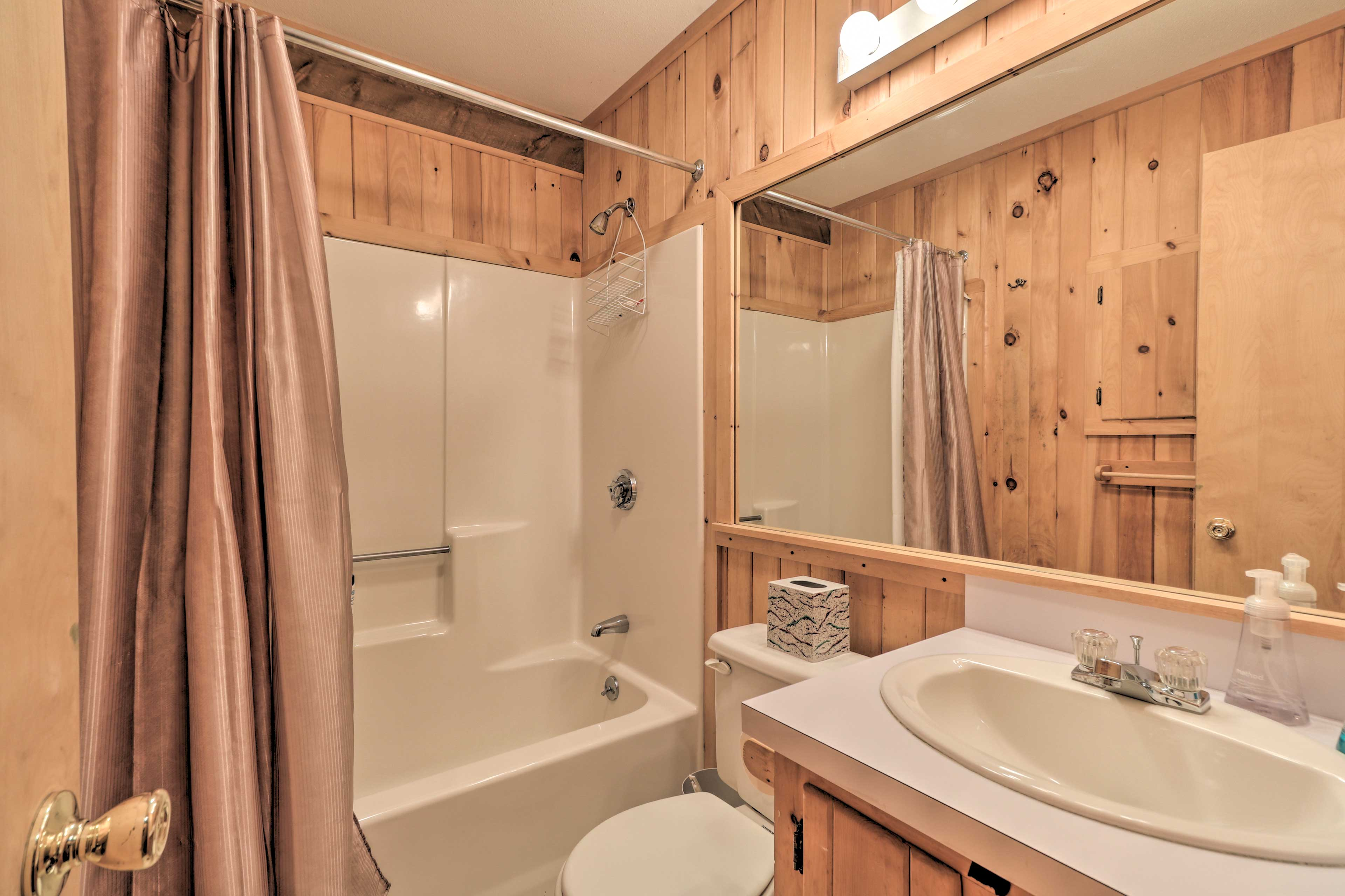 The final bathroom is equipped with a shower/tub combo.