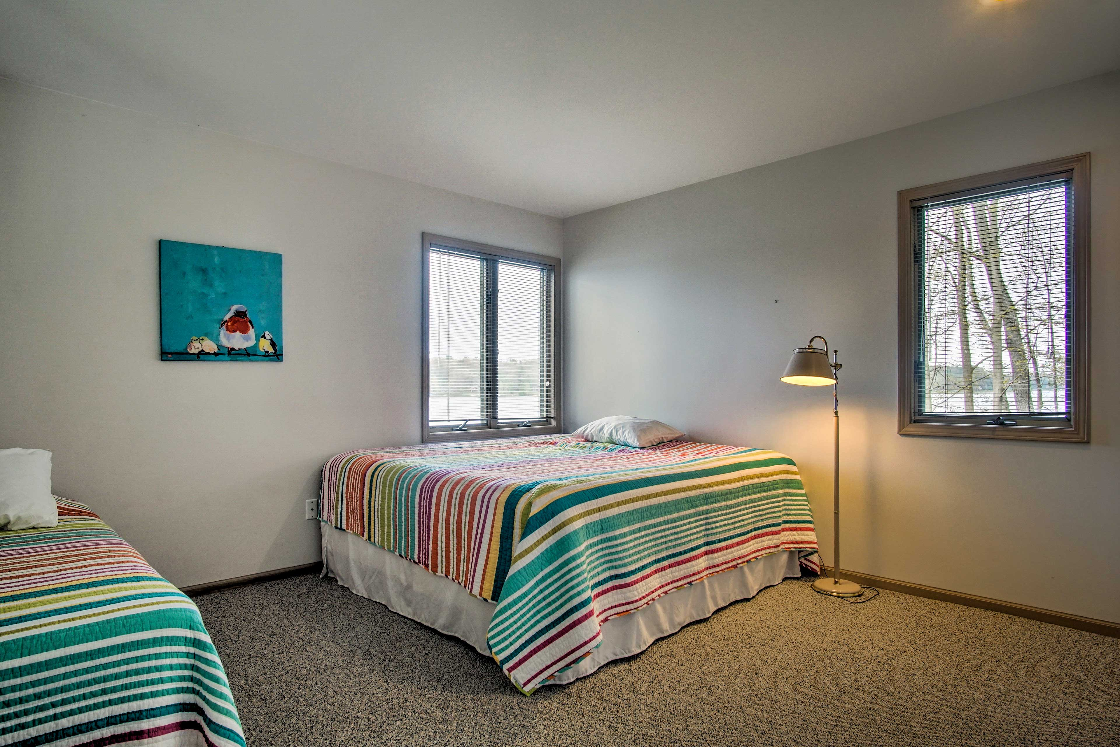 This bedroom offers a king bed and twin bed.