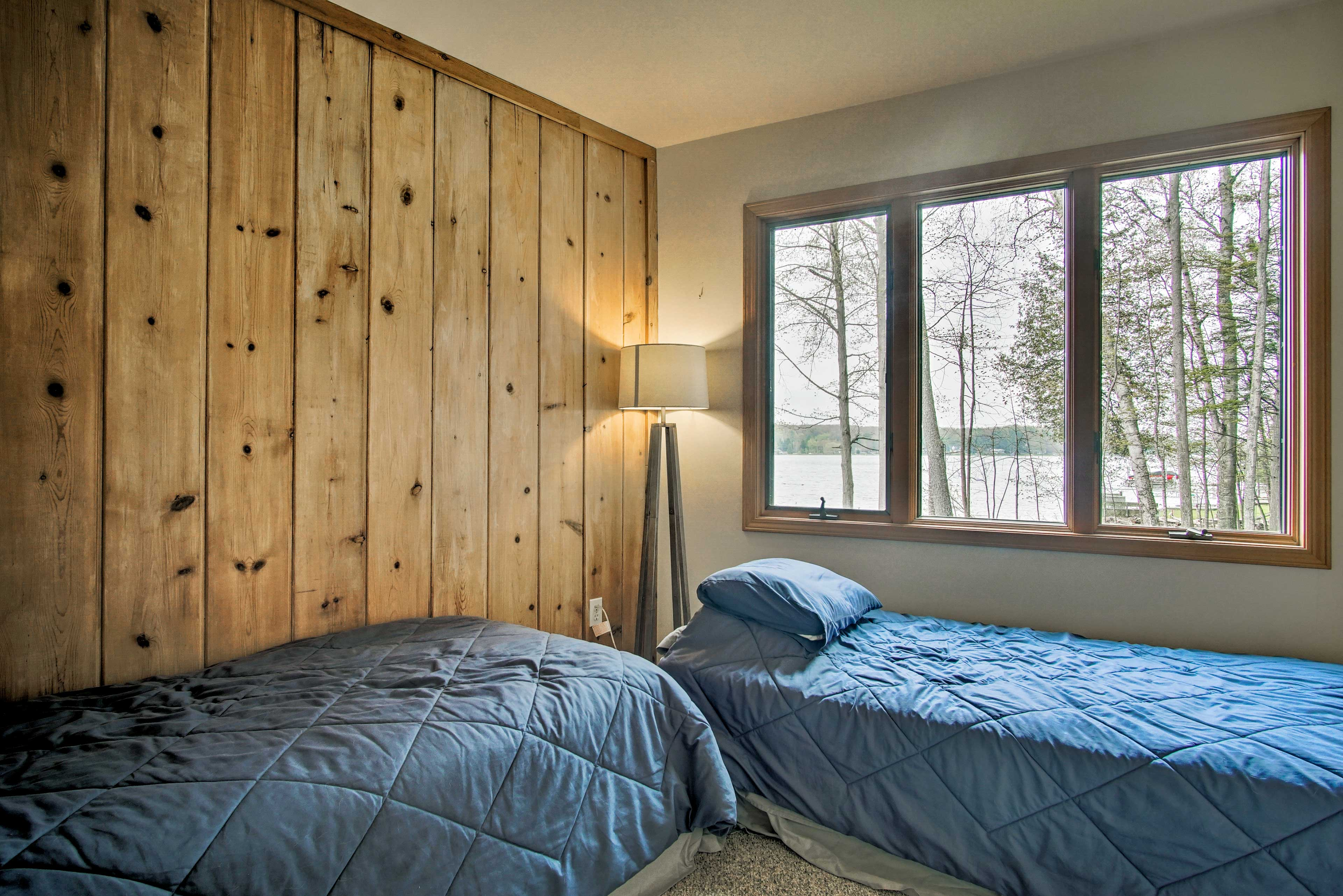 Two more travelers can drift to sleep in these twin beds.