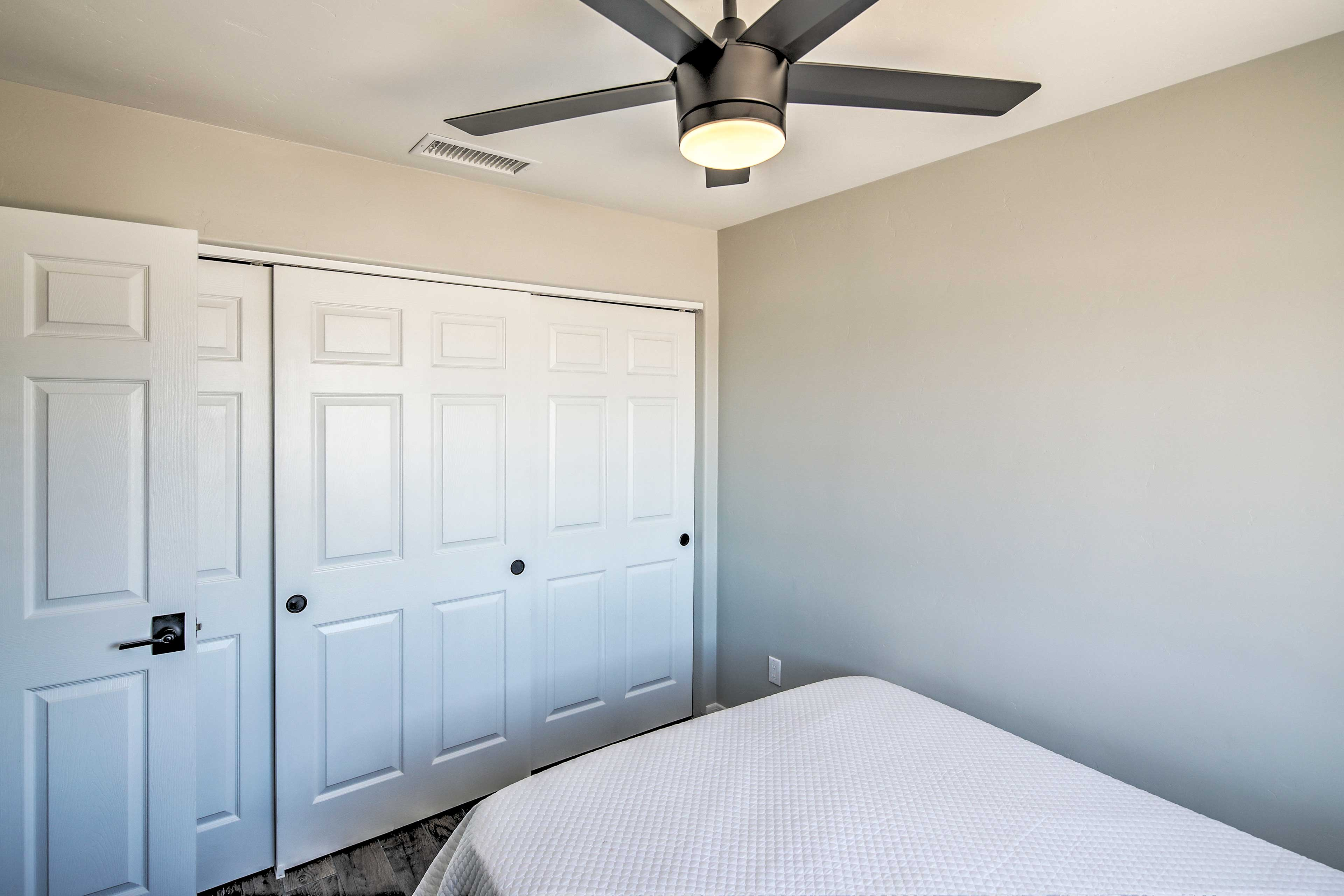 The room is complete with a ceiling fan and spacious closet.