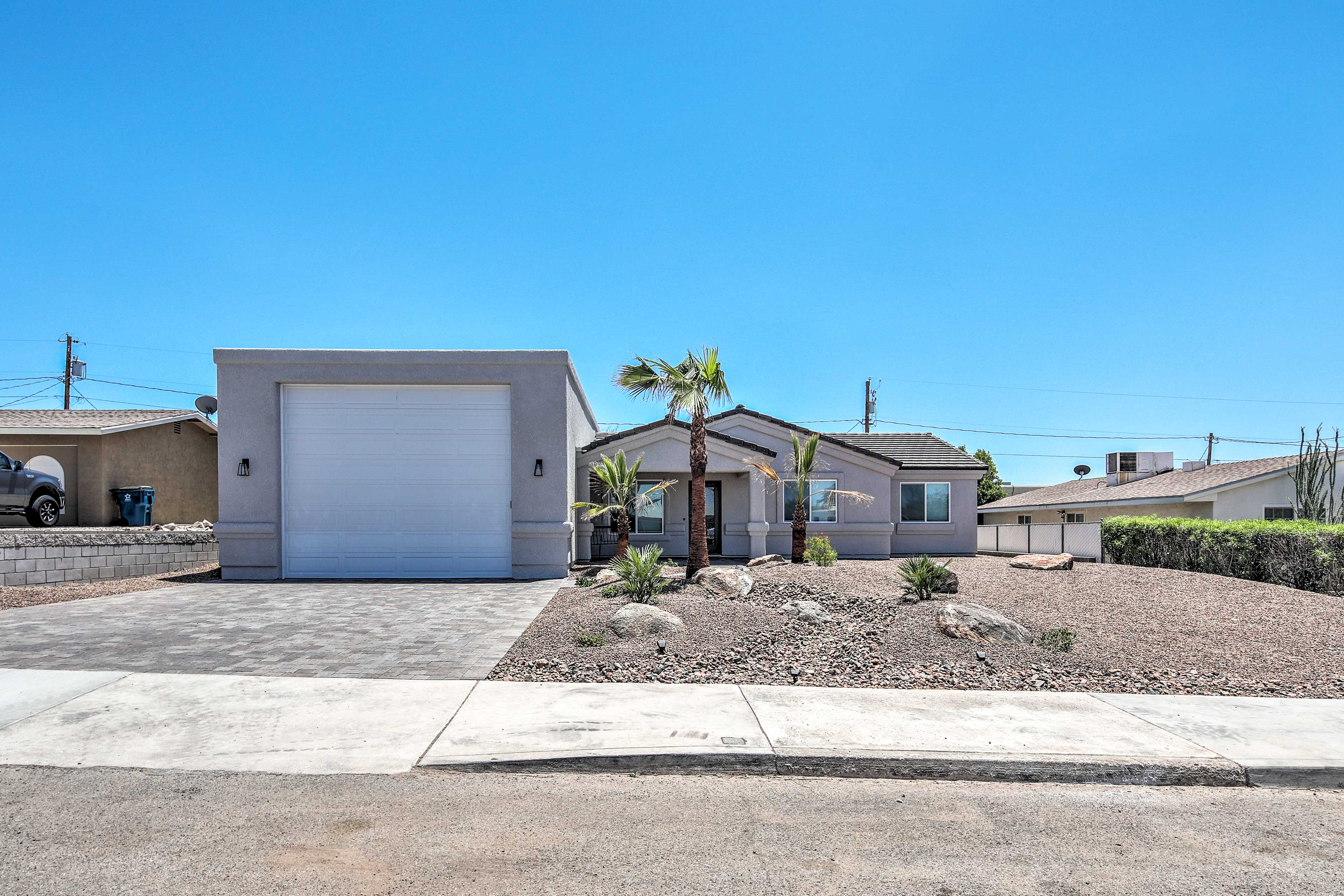 Garage, driveway, and street parking are available.