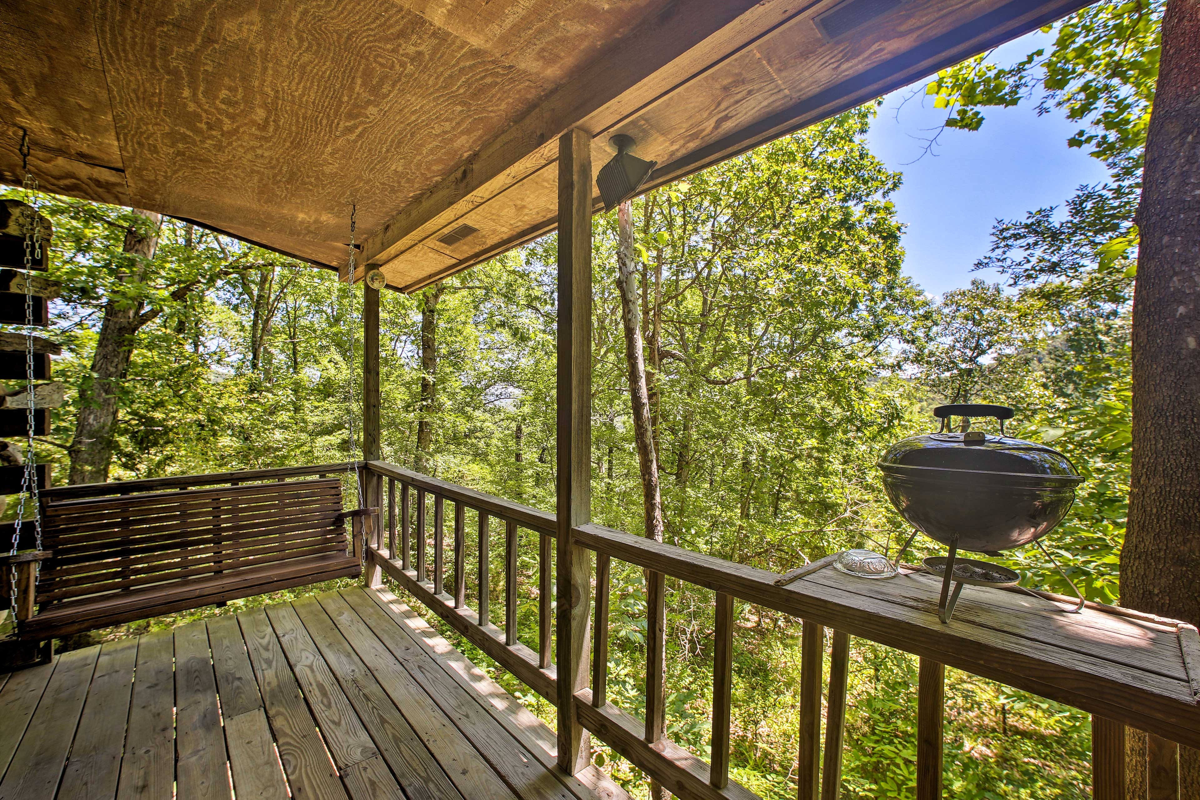 This studio vacation rental features a private deck and grill.