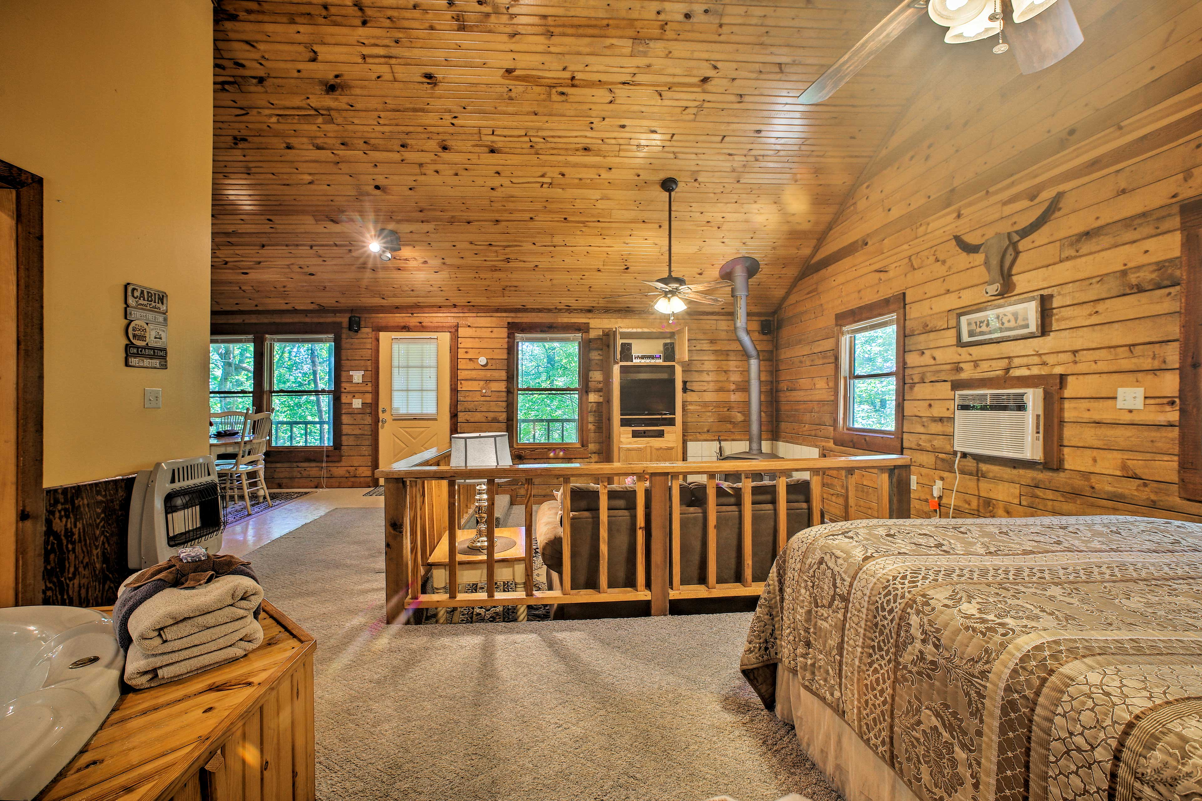 Wood paneling adds a rustic ambiance.