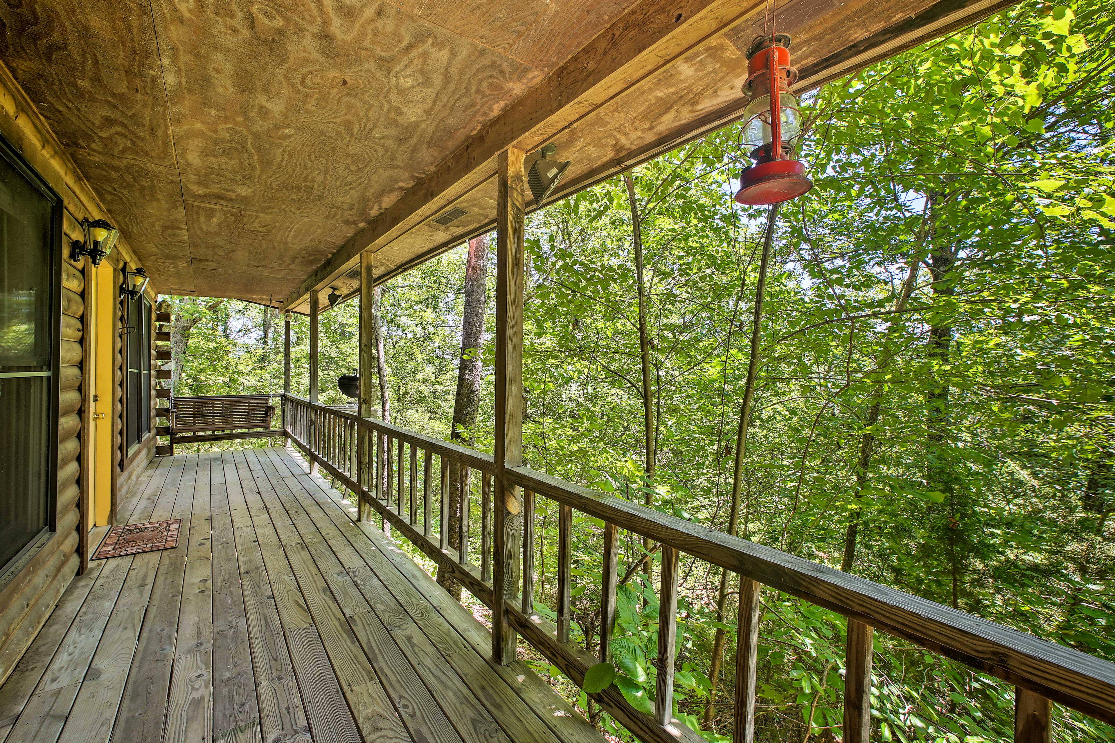 Take in the sounds of nature and forested views from the deck.