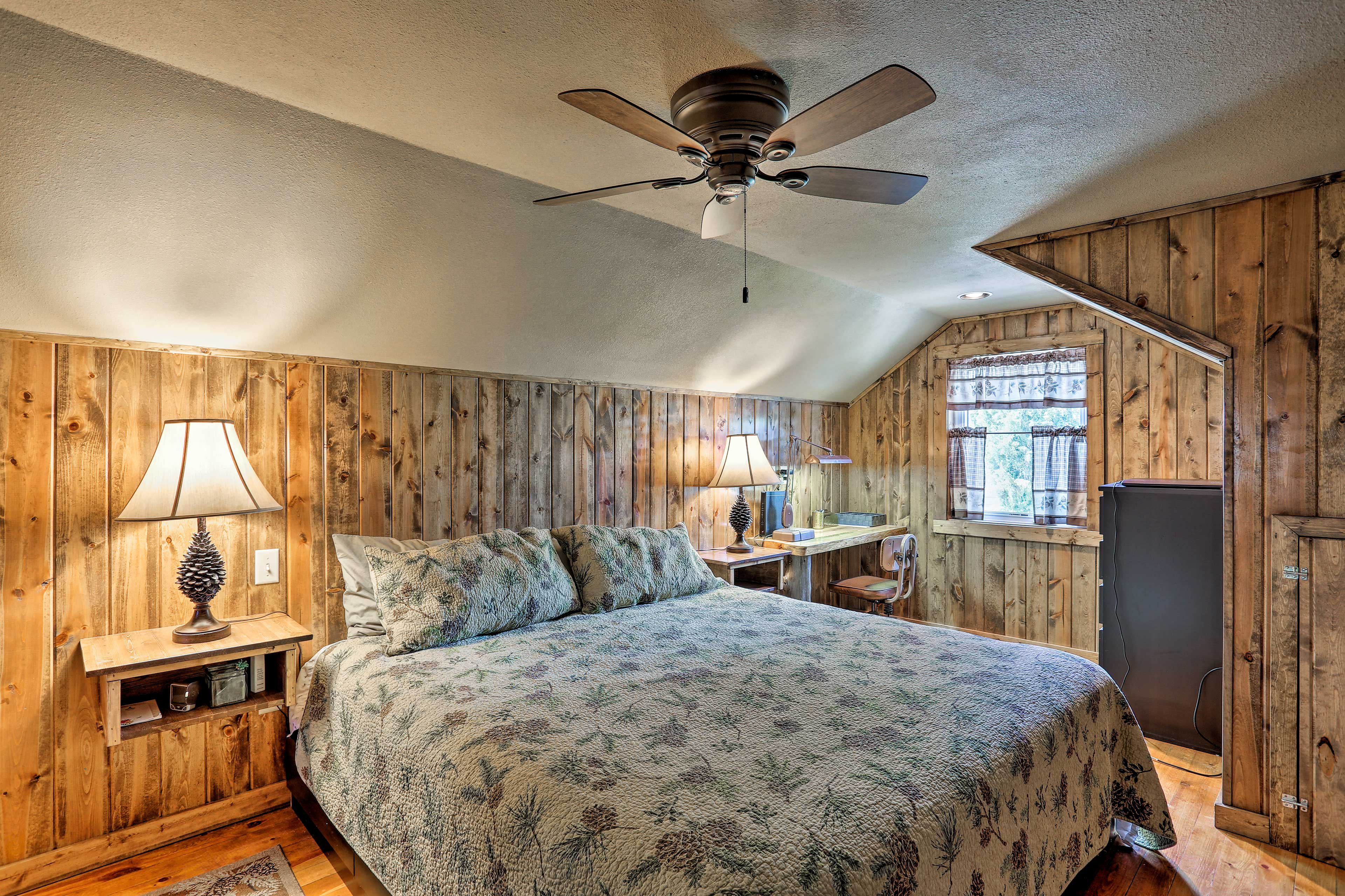 The master bedroom houses a king-sized bed.
