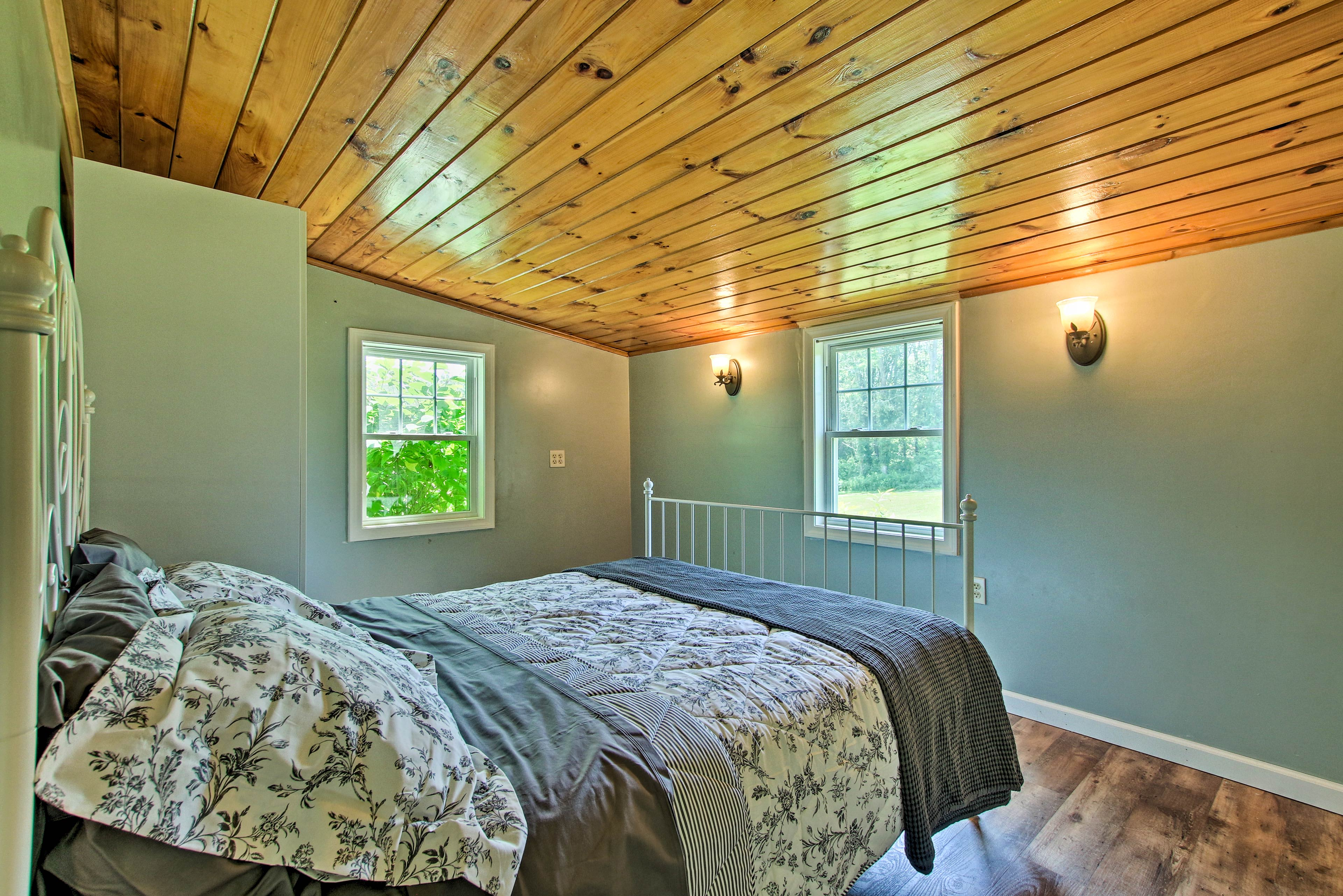 Step into the master bedroom with a queen-sized bed.