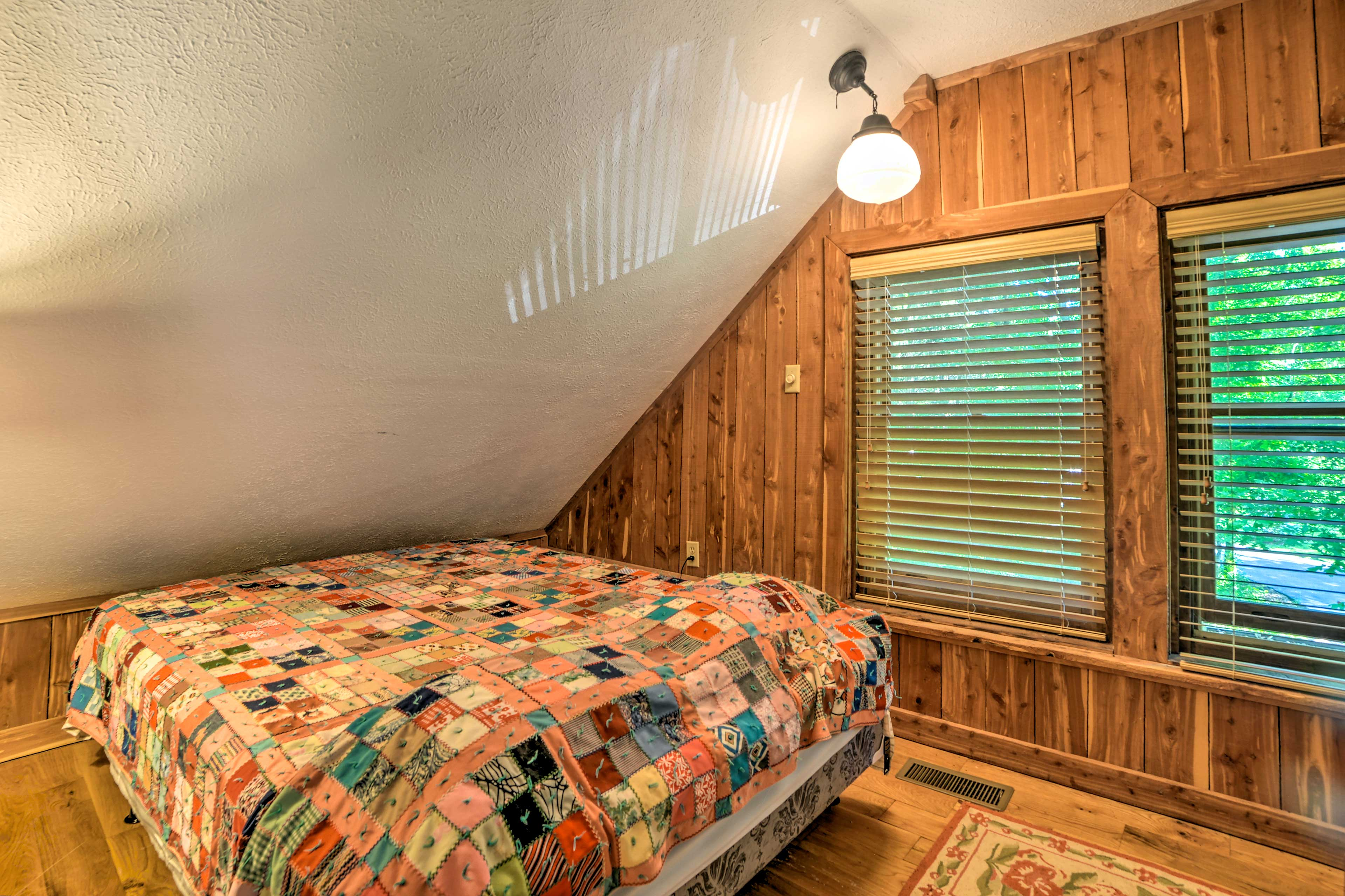 Two guests can share the comfort of this queen-sized bed.
