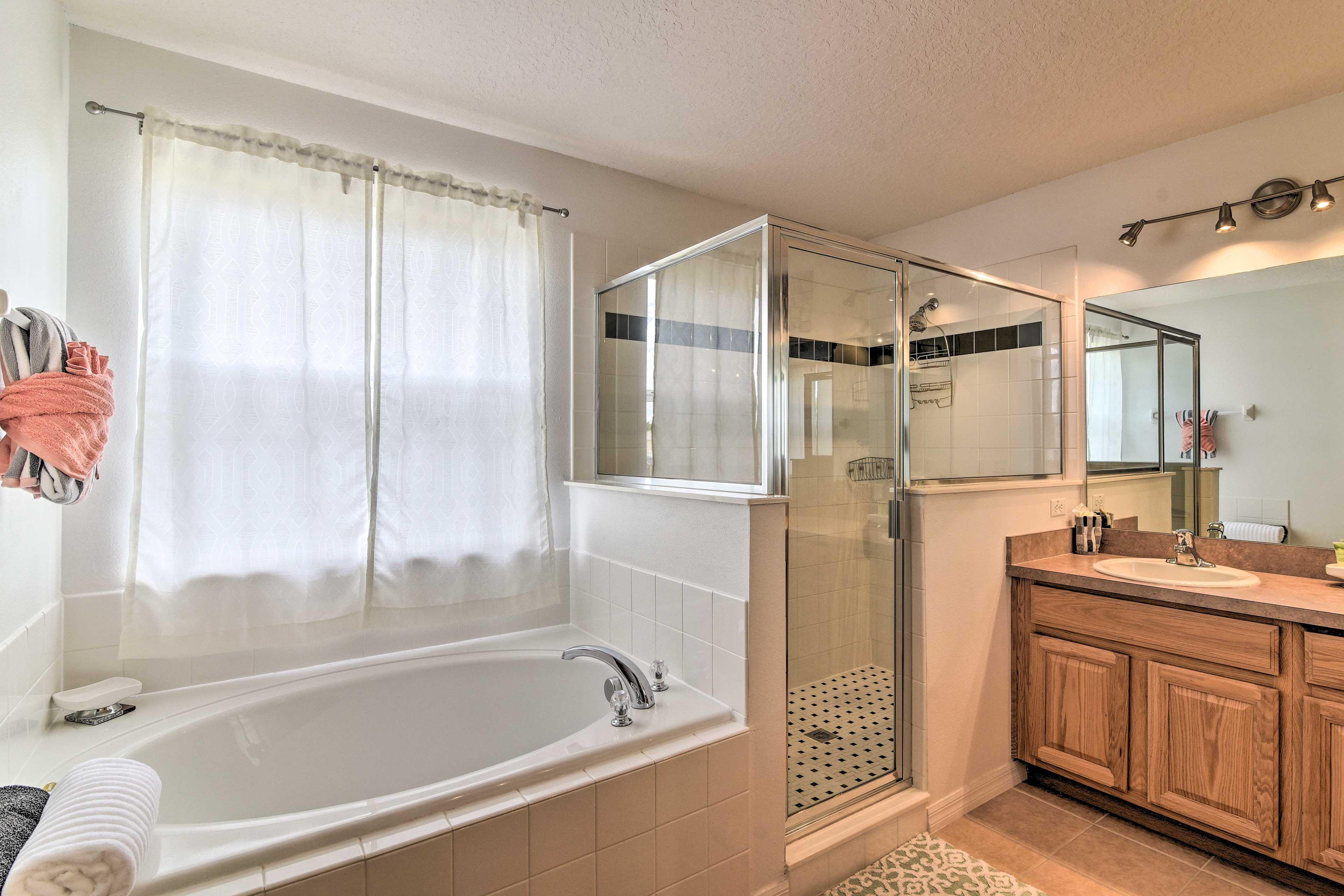 Take a relaxing soak in the large bathtub.