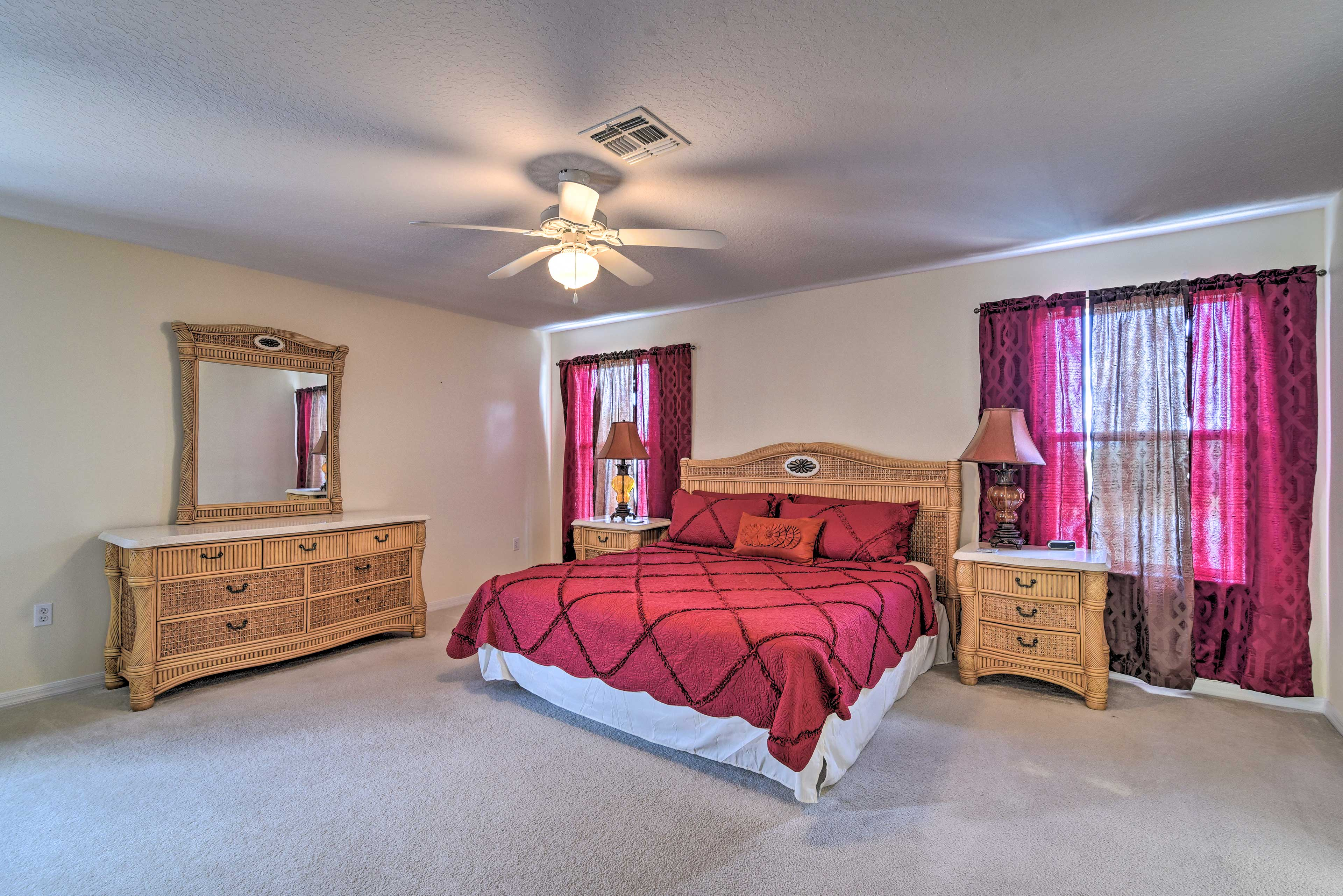 The master suite offers a king bed and sleeper sofa.